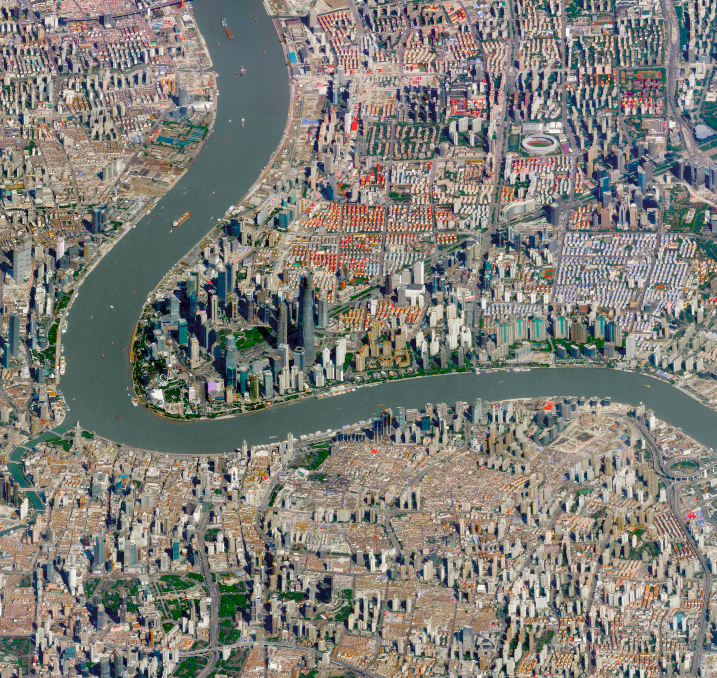 """Check out this incredible perspective of Shanghai, China, captured by a Planet satellite at a low angle. With more than 24 million residents, Shanghai is the most populous city in China and the second-most populous city proper in the world. Many of Shanghai's landmarks are visible in this Overview, including the Oriental Pearl Tower, the Jin Mao Tower, and the Shanghai World Financial Center.  31°14'05.0""""N, 121°30'23.0""""E  Source imagery: Planet"""