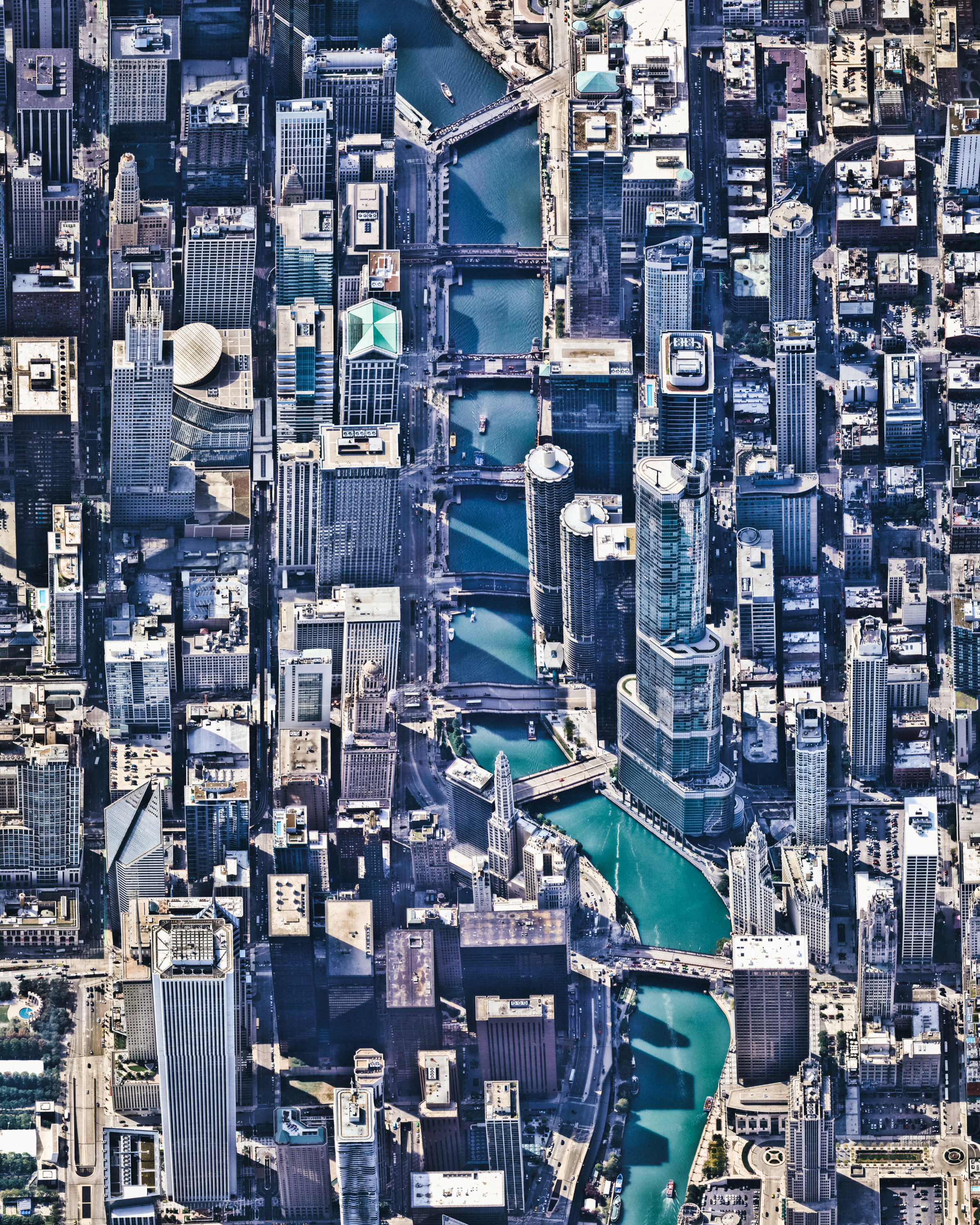 """Chicago, Illinois, is the third most populous city in the United States, with more than 2.7 million residents. This Overview shows the Chicago River flowing through the city center, dividing The Loop (left) and Near North Side (right) communities. Many of the city's prominent skyscrapers can be seen from this perspective, including the Trump International Hotel and Tower, the Aon Center, and Grant Thornton Tower.  41°53'20.0""""N, 87°37'36.0""""W  Source imagery: Nearmap"""