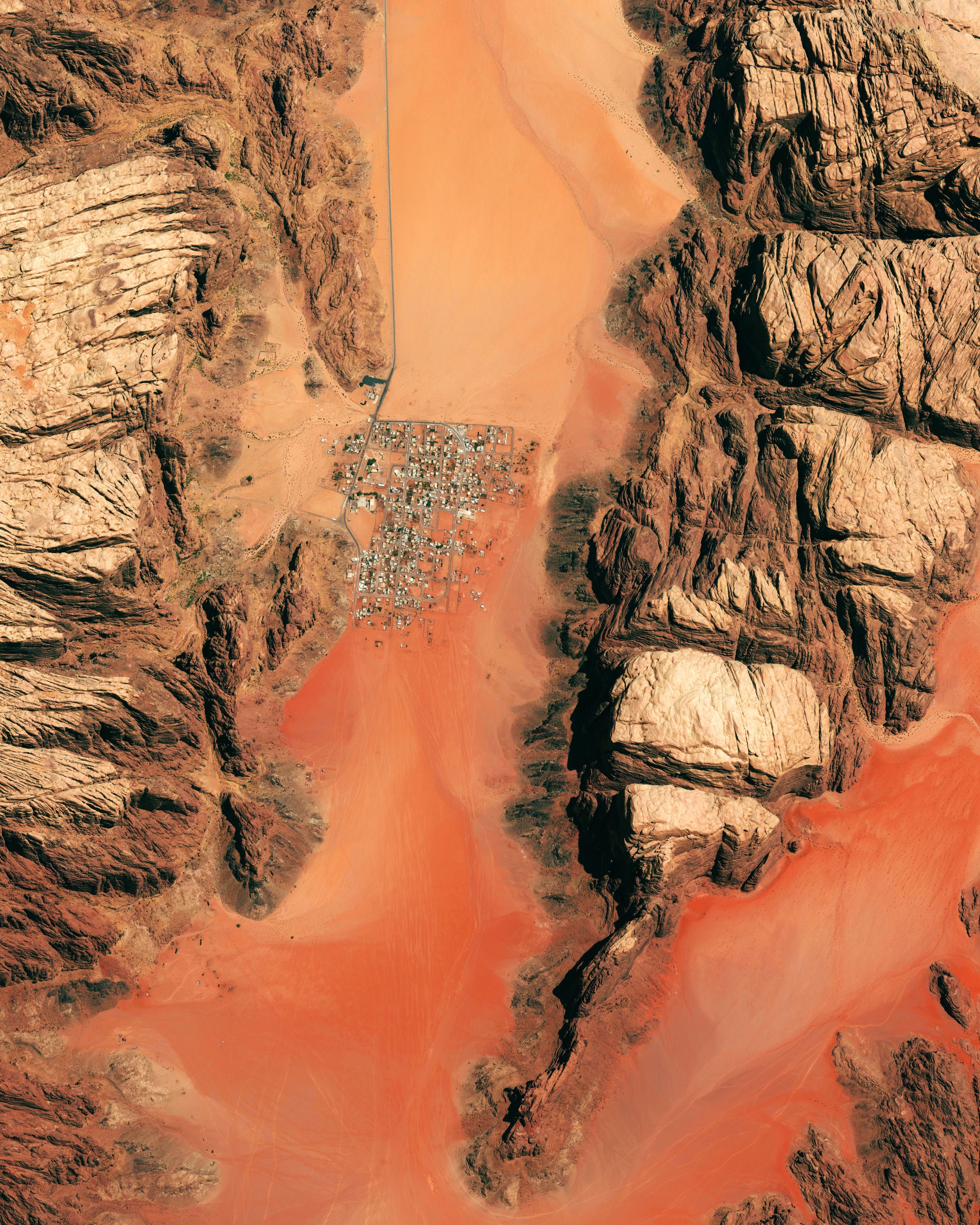"This Overview of Wadi Rum, Jordan, is now 20% off in our Printshop! Just use the code ""HOLIDAY20"" to get your discount on any print order. Head over to our  Printshop  now to check out what's available! Wadi Rum is a village that has been populated by humans since prehistoric times (8th century BC). Early inhabitants left their mark in the form of rock paintings, which have been thoroughly analyzed by historians. The area has also served as a film set for movies such as The Martian and Star Wars Rogue One.  29°35'35.0""N, 35°25'12.0""E  Source imagery: DigitalGlobe"