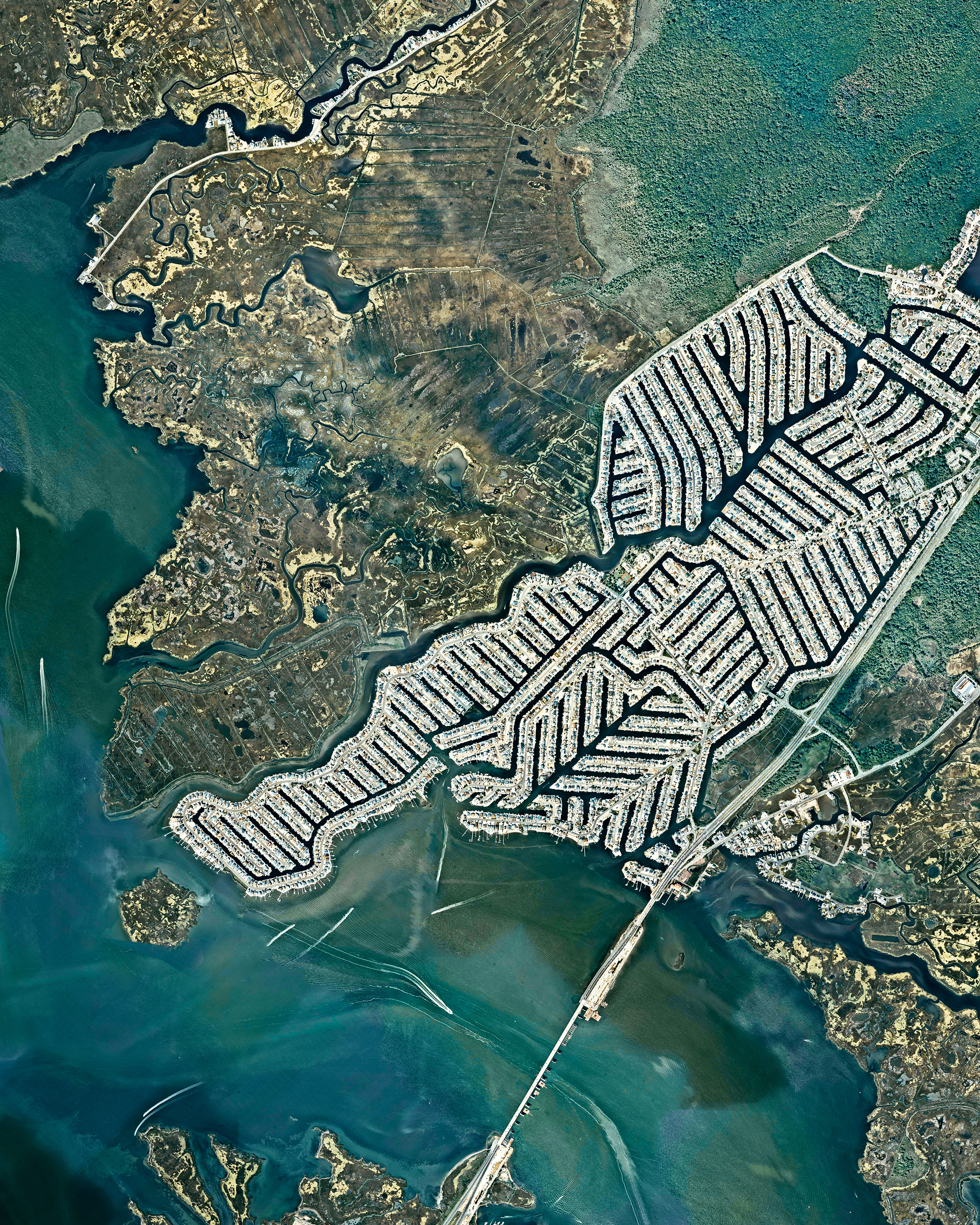"Beach Haven West is an unincorporated community and census-designated place in Stafford Township, New Jersey. The neighborhood, which has about 3,900 residents, was built upon salt marshes beginning in the 1950s. Looking at this Overview, it is evident that Beach Haven West was supposed to continue growing; however, a lack of permits from the Environmental Protection Agency and the Wetlands Protection Act of 1970 prevented it from expanding further across the Mill Creek delta.  39°40'13.5""N, 74°13'59.2""W  Source imagery: Nearmap"