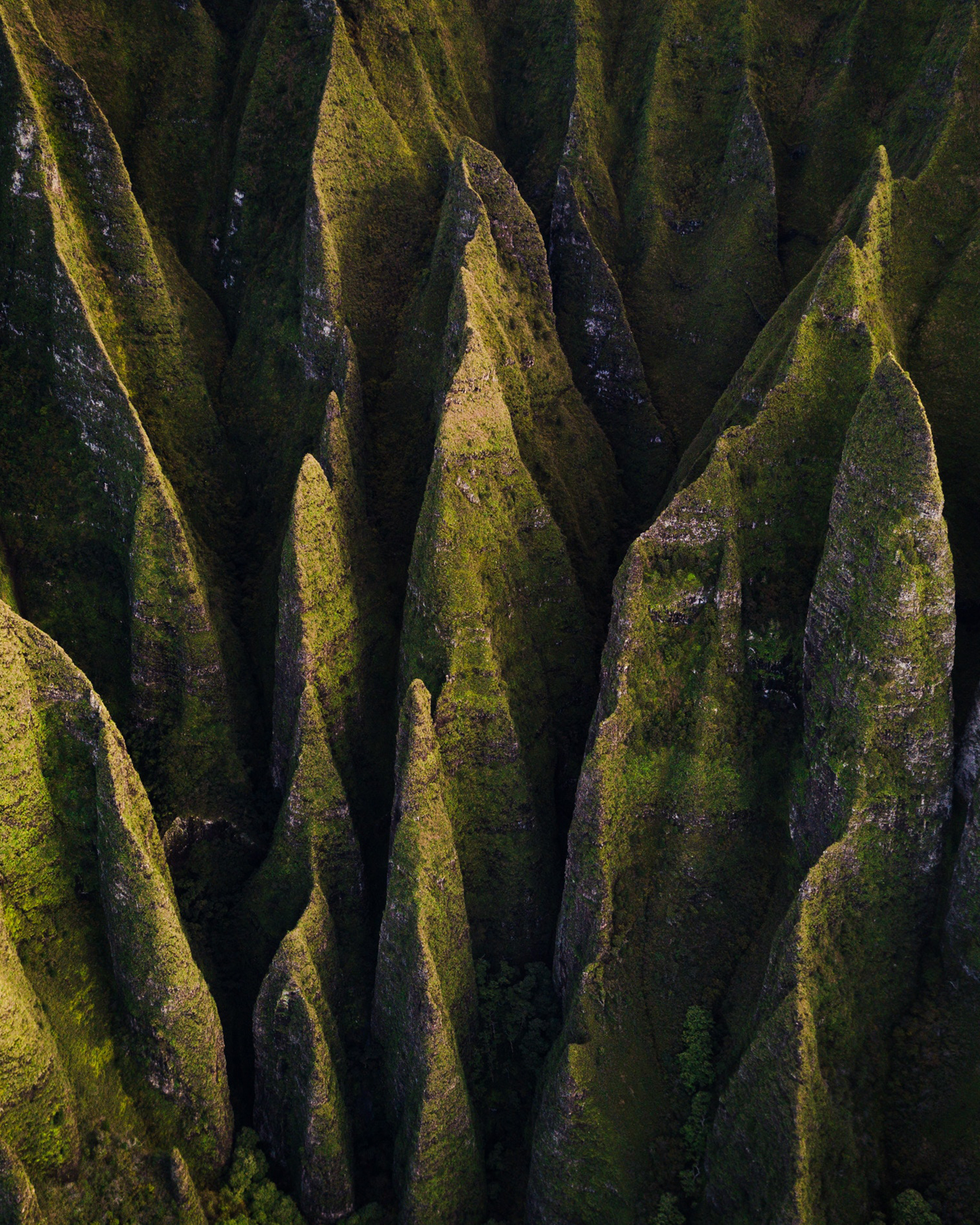 """Check out this amazing capture above Nā Pali Coast State Park, located along the northwest side of Kauai in the Hawaiian Islands. """"Nā Pali"""" means """"many cliffs"""" in Hawaiian, and some such cliffs rise to roughly 4,000 feet (1,200 m) above the Pacific Ocean. This area is inaccessible by vehicle, but can be reached by hiking or helicopter, as well as from the ocean by kayak or paddleboard.  22°10'31.9""""N, 159°38'37.0""""W  Source imagery: Spencer Watson (@thebrownspy)"""