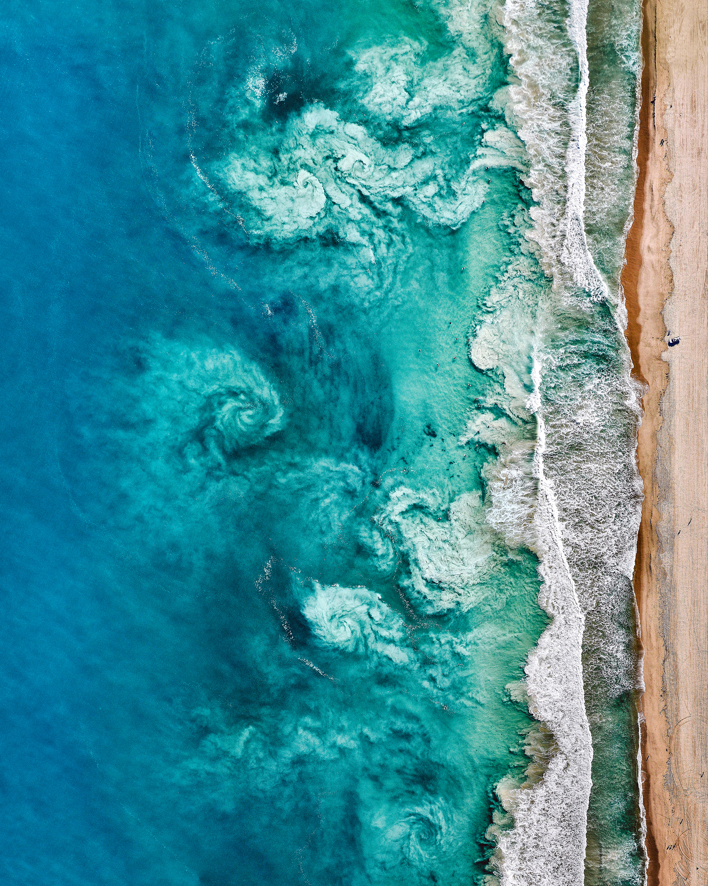 """With just hours left in 2018, we're sharing one more of our favorite Overviews created this year. This amazing shot shows swirling waves offshore Perth, Australia. The beaches in Perth are world-famous for their beautiful white sand and clear blue water. A sincere thank you to everyone who shared an image, purchased a print or a copy of """"Overview,"""" or simply followed along in 2018. Happy New Year!  31°57'04.5""""S, 115°45'14.9""""E  Source imagery: Nearmap"""