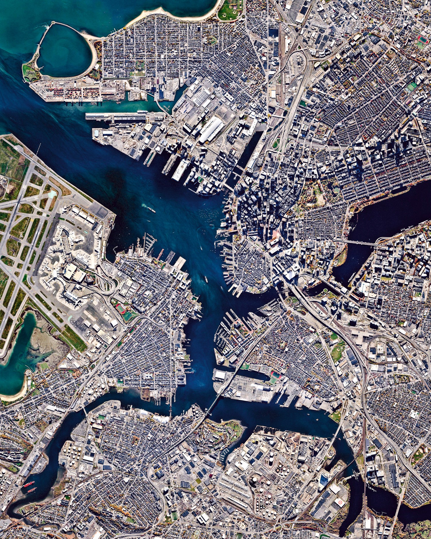 """Boston is the capital and most populous city in the Commonwealth of Massachusetts, with more than 4.6 million people in its metro area. In this Overview, three waterways can be seen flowing through the city and emptying into Boston Harbor — Chelsea Creek at left; the Mystic River in the center; and the Charles River at right.  42°21'29.0""""N, 71°03'49.0""""W  Source imagery: Nearmap"""