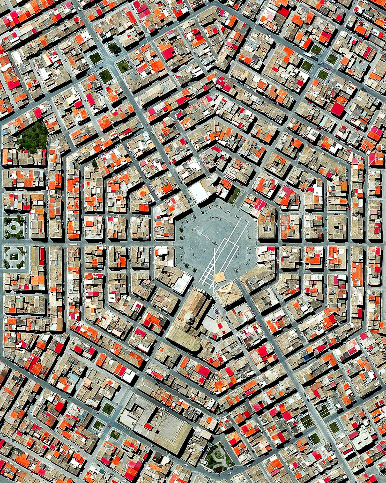 """Grammichele is located on the island of Sicily in southern Italy. The town was constructed in 1693 with a distinctive hexagonal street plan after an earthquake destroyed the nearby, old town of Occhialà.  37°12'53.0""""N 14°38'11.0""""E  Source imagery: DigitalGlobe"""