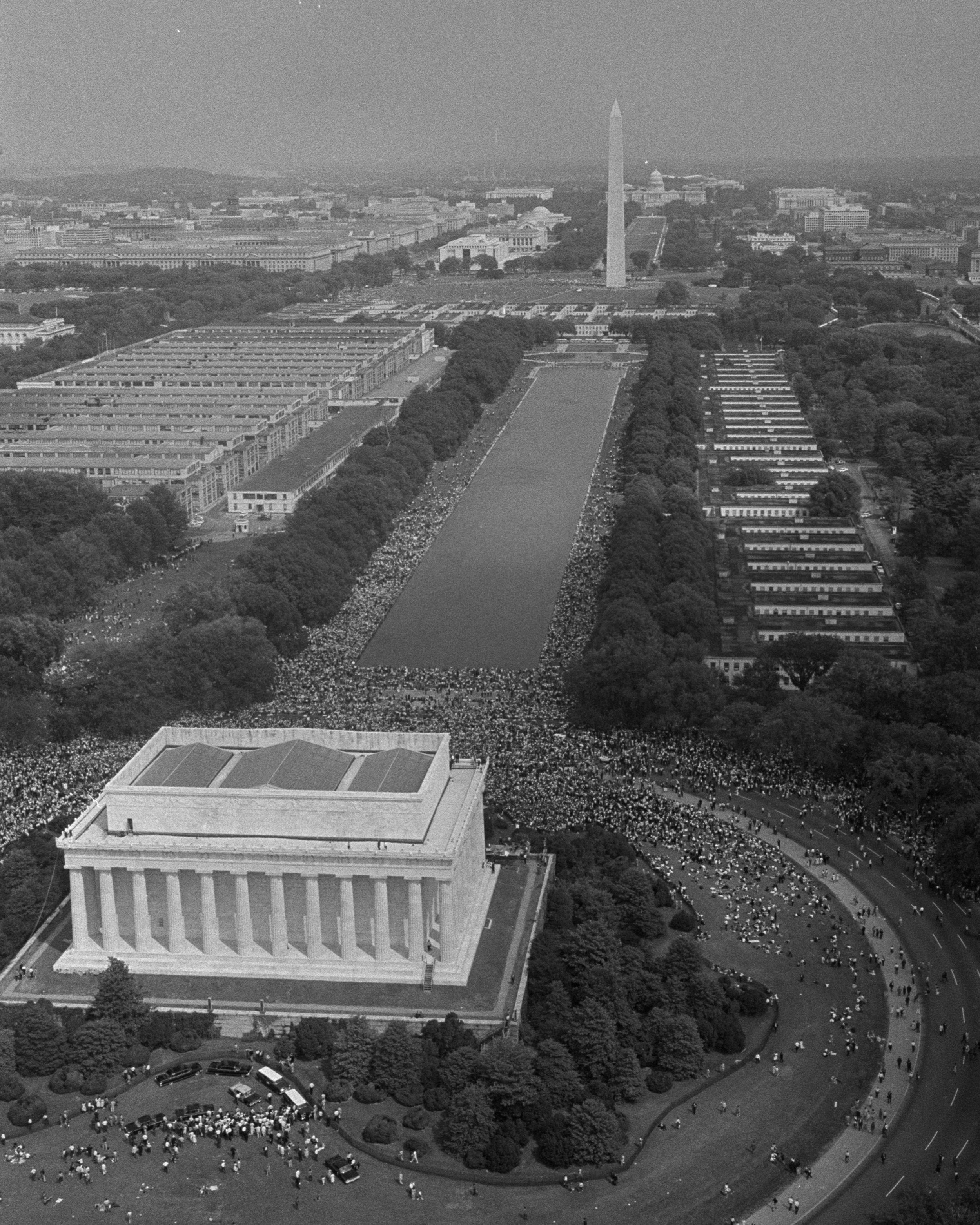 """On August 28, 1963, more than 250,000 civil rights supporters gathered in Washington, D.C. to hear Martin Luther King Jr.'s famous """"I Have a Dream"""" speech. As shown in this Overview, listeners stretched from the steps of the Lincoln Memorial all the way to the Washington Monument, a distance of nearly one mile (1.3 km). Today — the third Monday of January — marks Martin Luther King Jr. Day in America, a day to remember his life and contributions to the Civil Rights Movement.  38°53'21.0""""N, 77°03'03.1""""W  Source imagery: The Library of Congress"""