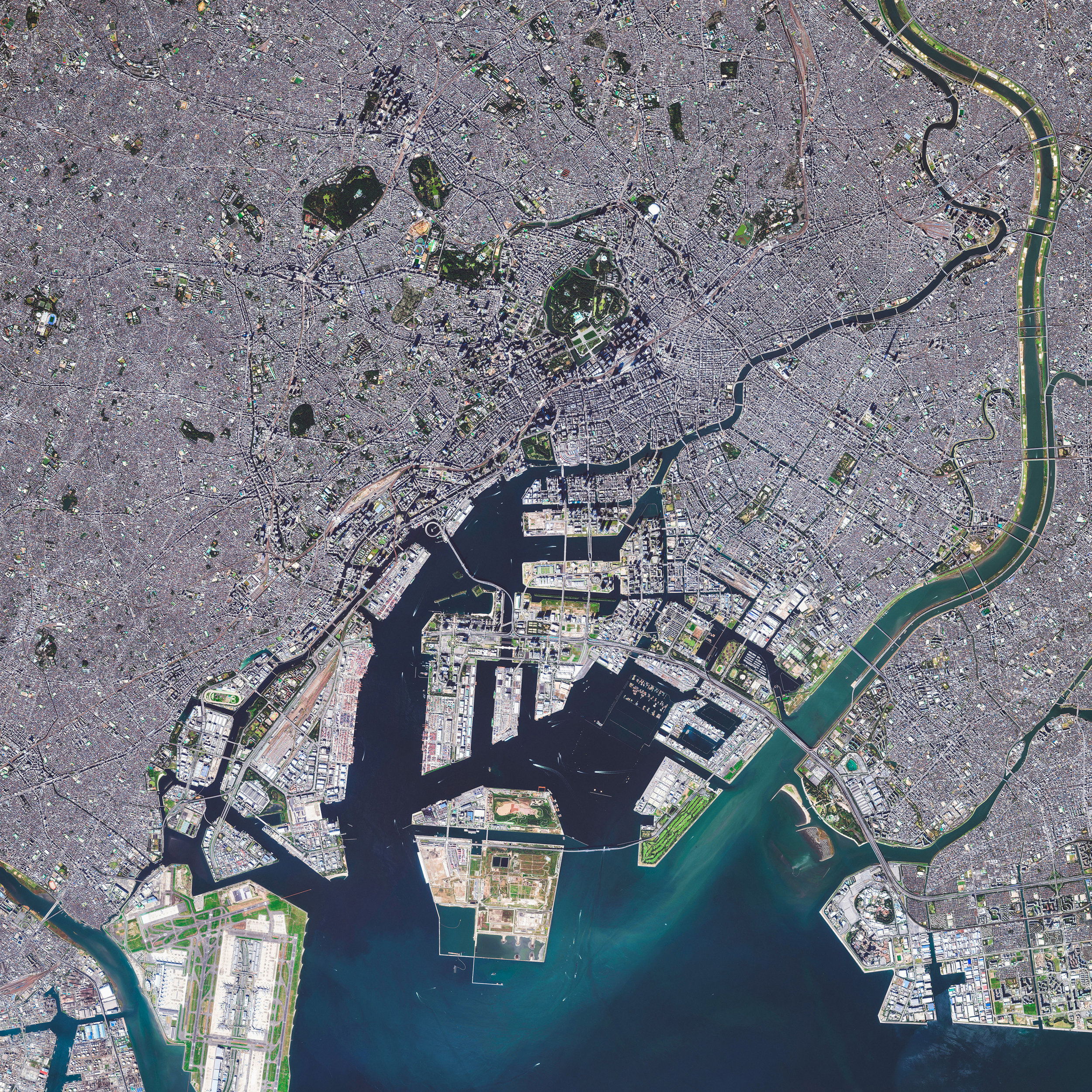"""Tokyo is the capital of Japan and the most populous metropolitan area in the world, with upwards of 38 million residents. Also, as of 2014, it had the largest metropolitan economy in the world, boasting a total gross domestic product (GDP) of $1.6 trillion. This Overview captures just a small portion of the city on Tokyo Bay, with the Arakawa River featured on the right-hand side.  35°40'00.0""""N, 139°49'00.0""""E  Source imagery: DigitalGlobe"""