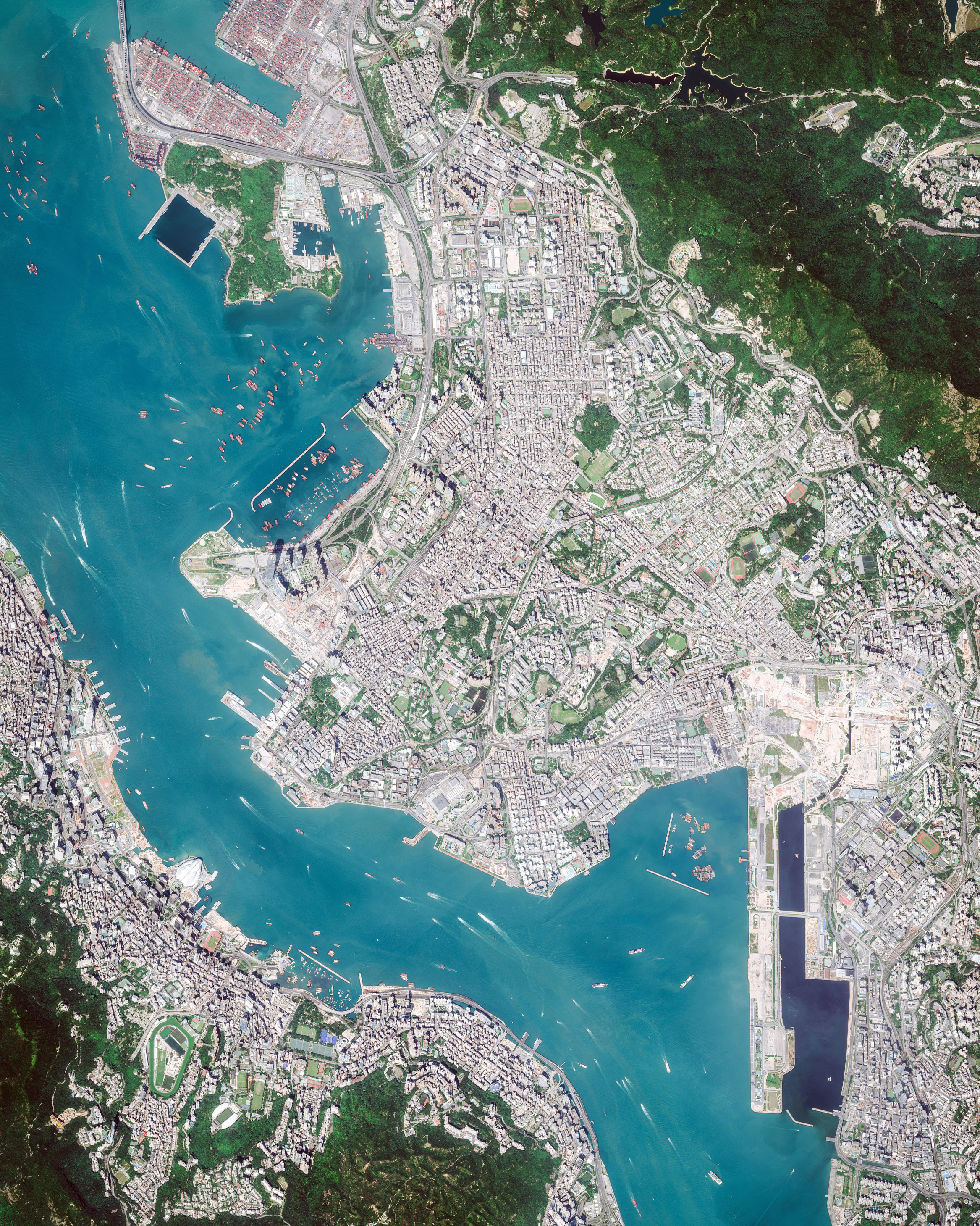 """Hong Kong is an autonomous territory — and former British colony — in southeastern China. Originally a sparsely populated area of farming and fishing villages, it has become one of the world's most significant financial centers and commercial ports. Hong Kong has the largest number of skyscrapers in the world, most of which surround Victoria Harbor and are captured in this Overview.  22°17'15.9""""N, 114°10'25.0""""E  Source imagery: DigitalGlobe"""