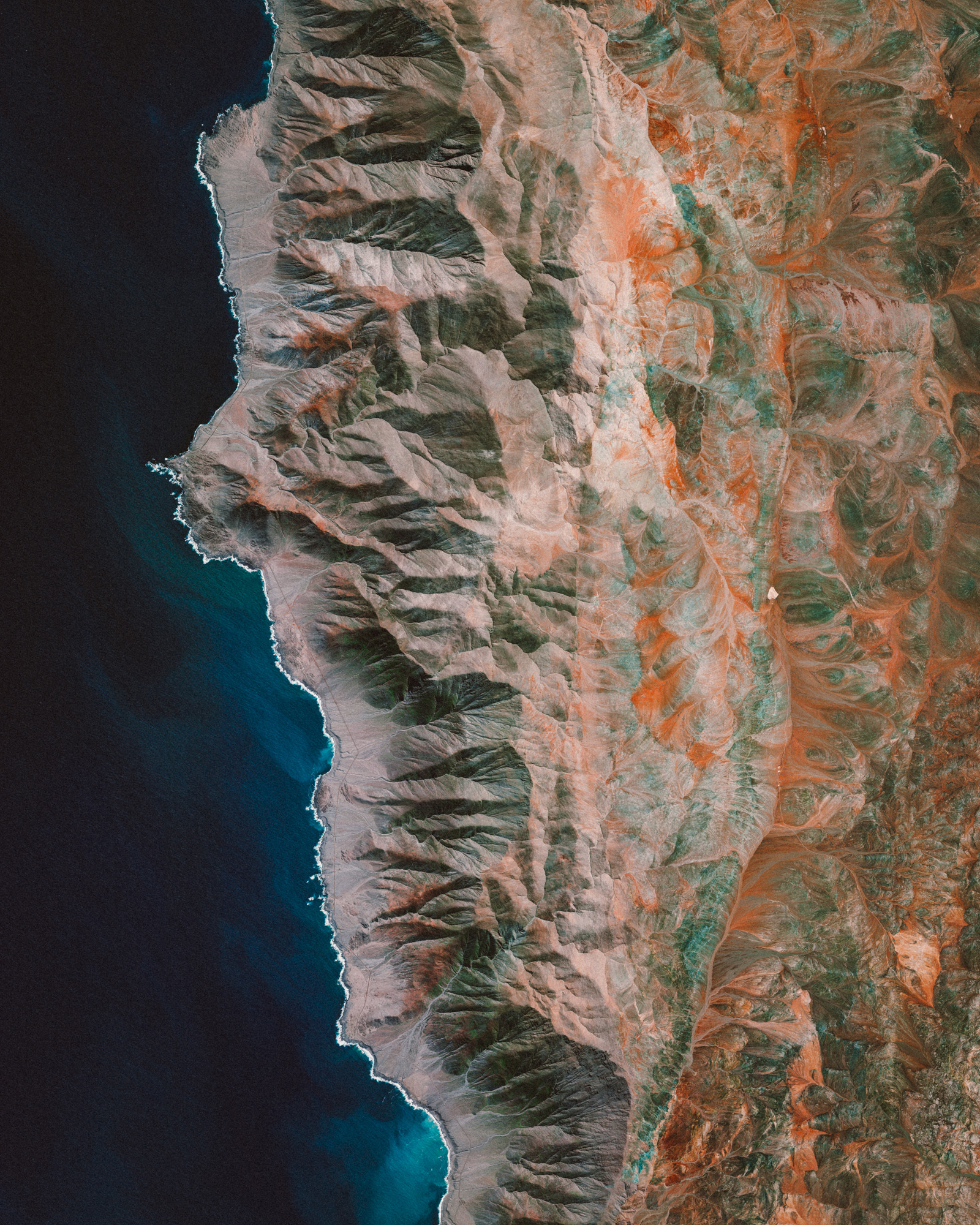 """Check out this amazing Overview of the Chilean Coast Range, which runs along the Pacific coast of Chile. It extends 1,900 miles (3,100 km) from north to south, and this image captures a section near the city of Antofagasta. The highest point in the Chilean Coast Range is Cerro Vicuña Mackenna, which peaks at 10,217 feet (3,114 m).  24°44'14.9""""S, 70°25'37.8""""W  Source imagery: DigitalGlobe"""
