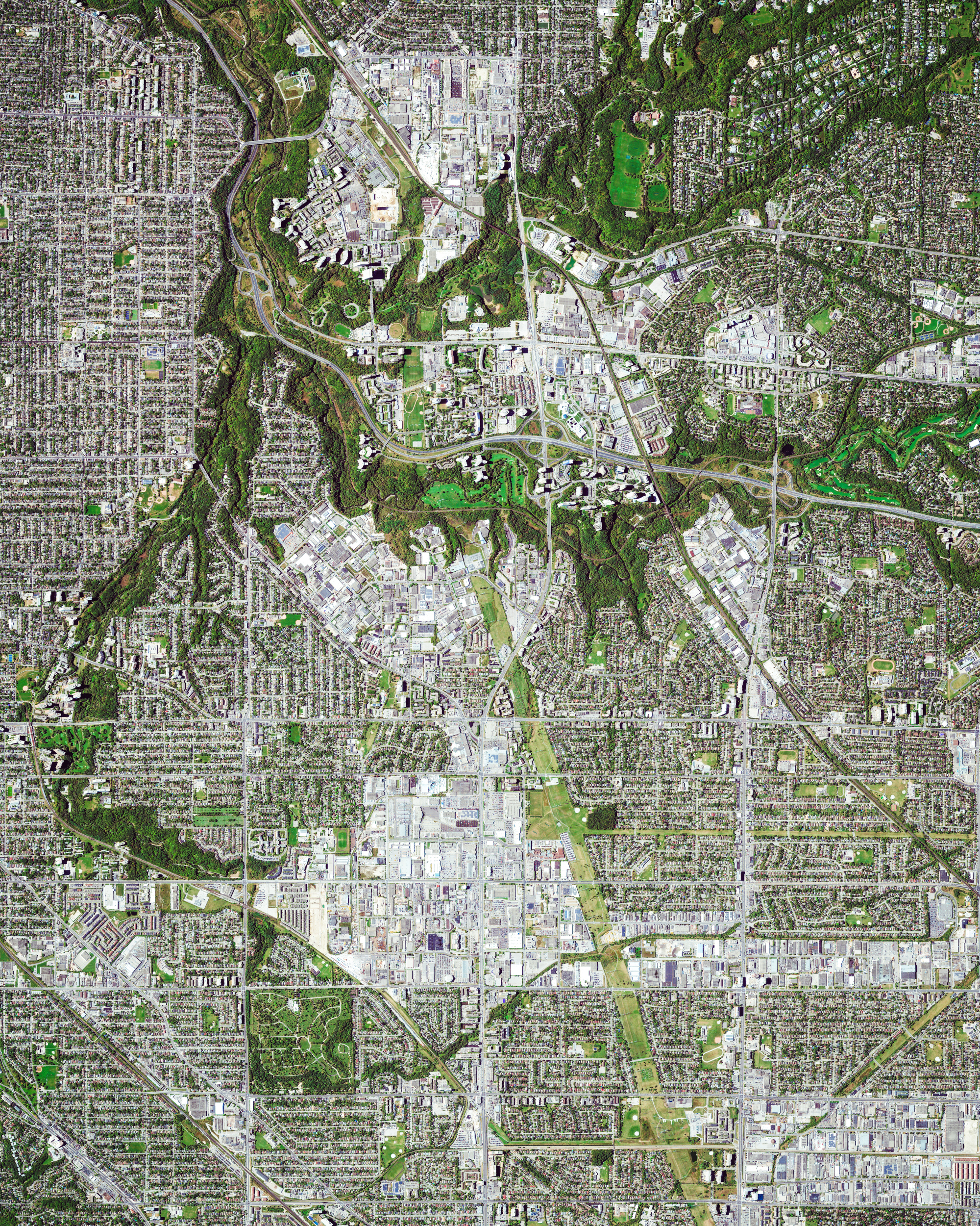 "Toronto is the most populous city in Canada, with upwards of 5.9 million people living in its metropolitan area. It is considered one of the most multicultural and cosmopolitan cities in the world; in fact, more than 50 percent of Toronto's residents belong to a visible minority group and more than 160 languages are spoken in the city. This Overview shows several of Toronto's neighborhoods, including pieces of East York, North York and Scarborough.  43°41'28.7""N, 79°19'40.1""W  Source imagery: DigitalGlobe"