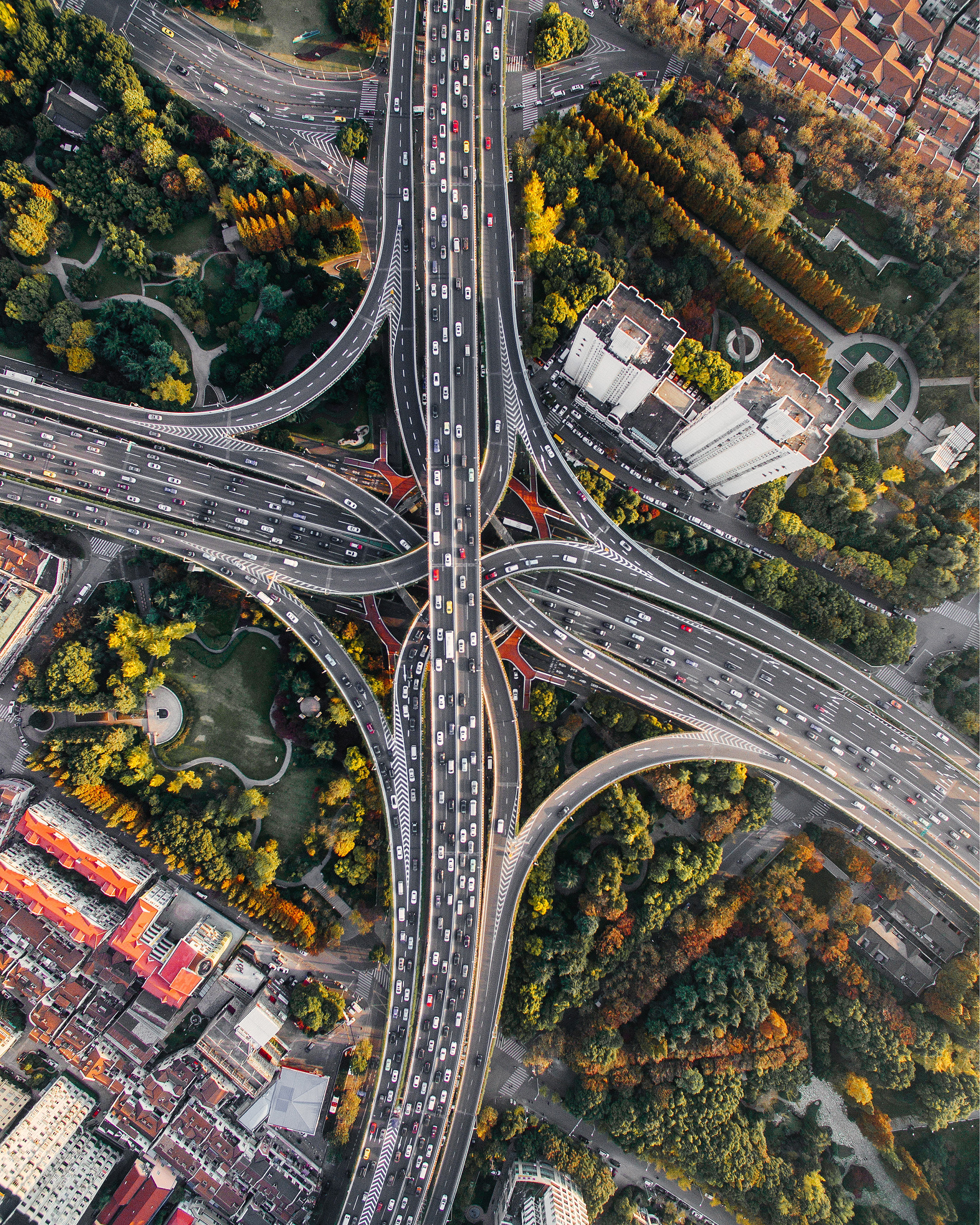 "The Puxi Viaduct in Shanghai, China, is one of the largest and busiest interchanges in the world. Its five levels of bridges connect two of the city's busiest highways, Nanbei Road and Yan'an Road, allowing thousands of vehicles to pass through every hour.  31°13'34.6""N, 121°27'52.5""E  Source imagery: Denys Nevozhai"