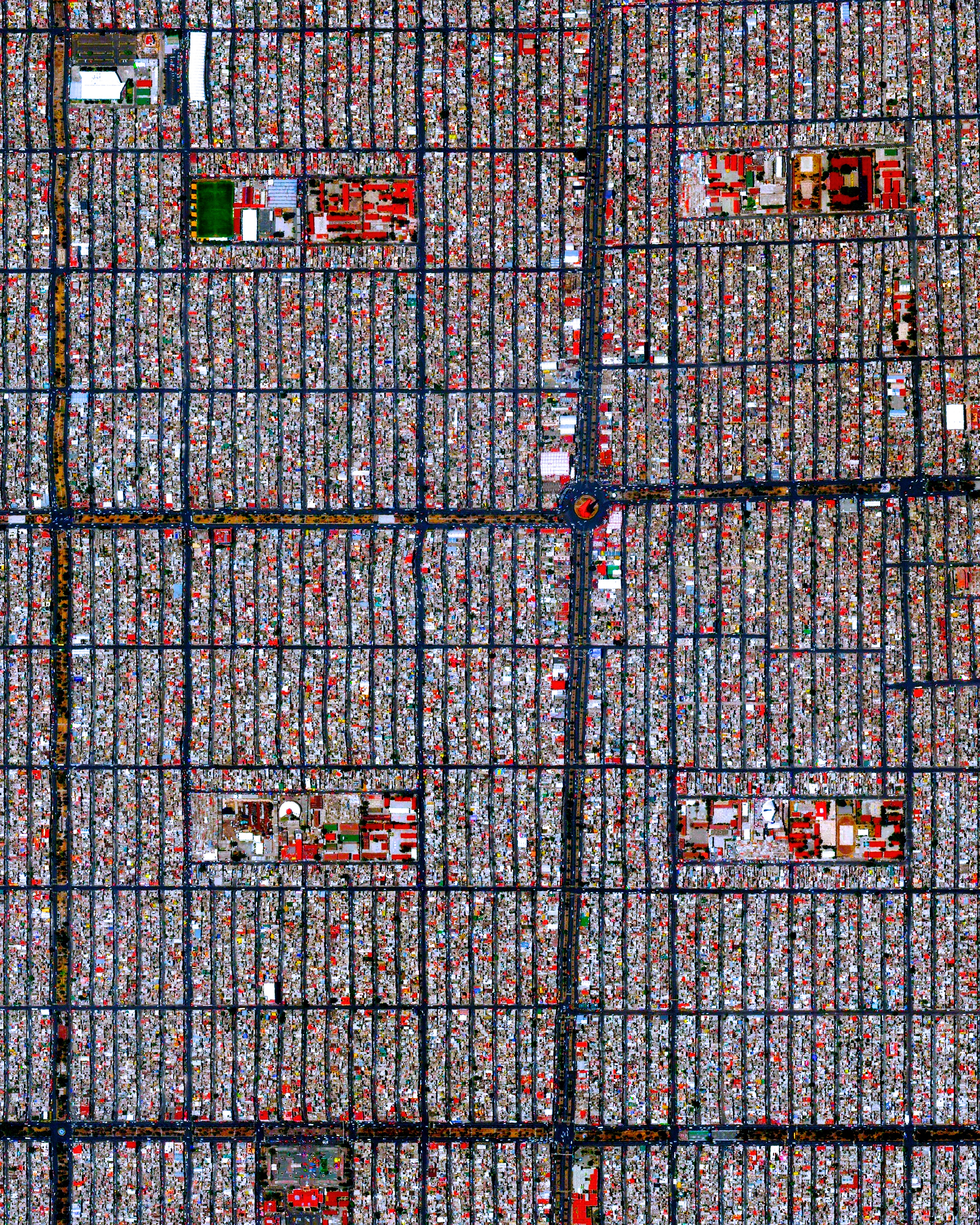"This Overview captures the tightly gridded streets of Nezahualcóyotl, a municipality of Mexico City. With a population of more than one million, this area is home to many of the capital's citizens who have migrated there from other parts of the country. The Greater Mexico City area has roughly 21 million residents, making it the largest metropolitan area in North America.  19°24'26.8""N, 99°01'40.2""W  Source imagery: DigitalGlobe"