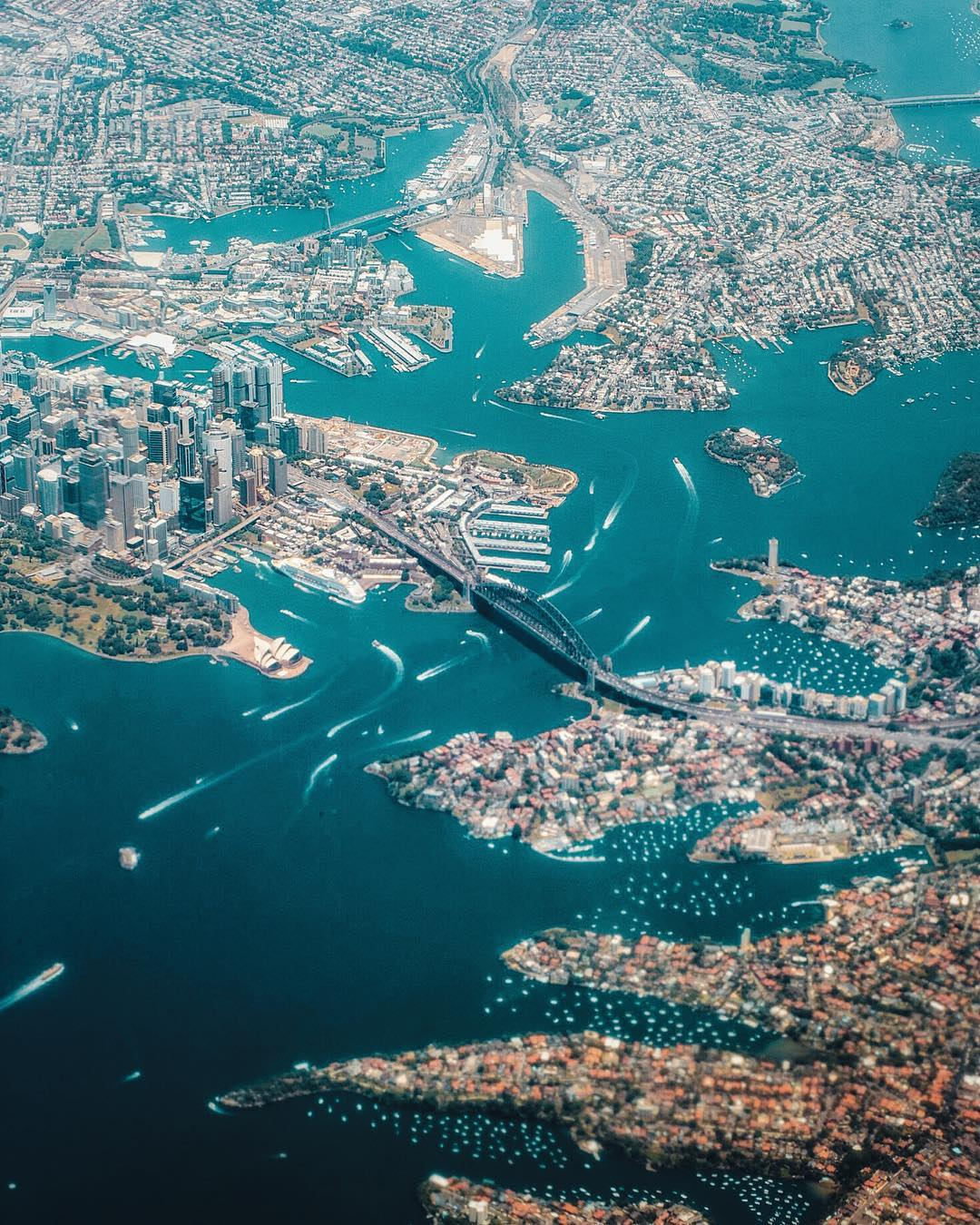 "Check out this awesome view of Sydney, Australia, taken from the window of a passenger jet leaving the city. Sydney covers a 4,775 square-mile (12,367-sq.-km) area and boasts roughly 2.5 million acres (1 million hectares) of nature reserves and parks. From this perspective, we can see many of the city's landmarks, including the Sydney Harbour Bridge, Sydney Opera House, Royal Botanic Gardens, Sydney Observatory, and others.  33°51'09.7""S, 151°12'38.3""E  Source imagery: Walt Loveridge"