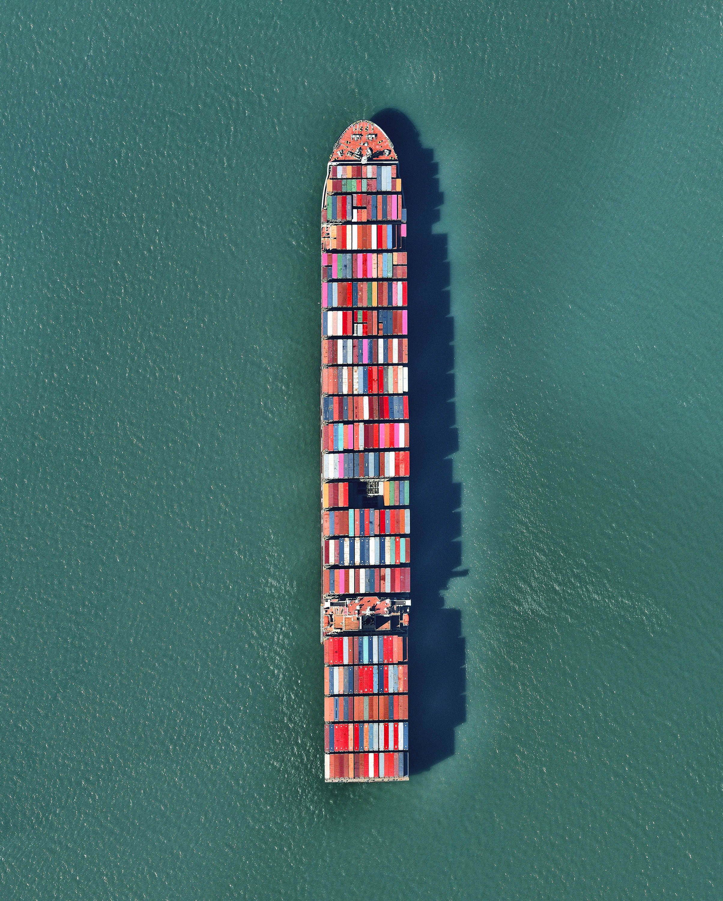 "A ship full of containerized cargo navigates San Francisco Bay, located between San Francisco and Oakland, California. Due to San Francisco's limited real estate, Oakland has served as the primary Bay Area port since the 1960s. The Port of San Francisco handled no containerized cargo in 2017, whereas the Port of Oakland had a throughput of nearly 2.5 million twenty-foot equivalent units (TEUs) that year.  37°46'01.3""N, 122°20'58.3""W  Source imagery: Nearmap"