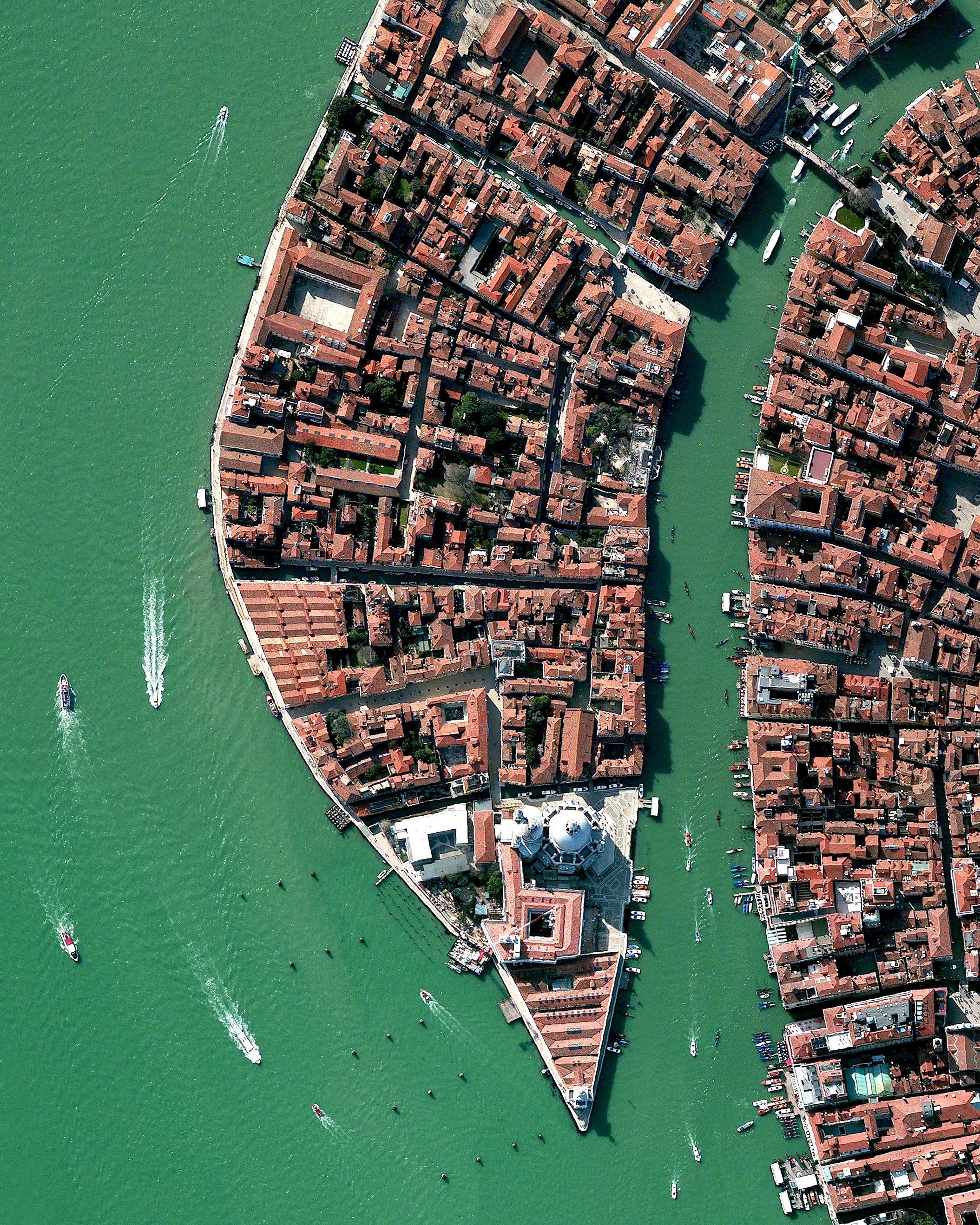 "This Overview shows part of the Dorsoduro sestiere in Venice, Italy. A sestiere — which comes from the Italian ""sesto,"" meaning sixth — is a subdivision of an Italian town or city divided into six districts. Dorsoduro is Venice's university district and is filled with bars, restaurants, indie shops, vintage fashion boutiques and art galleries, such as the Peggy Guggenheim Collection.  45°25'49.3""N, 12°20'00.4""E  Source imagery: DigitalGlobe"