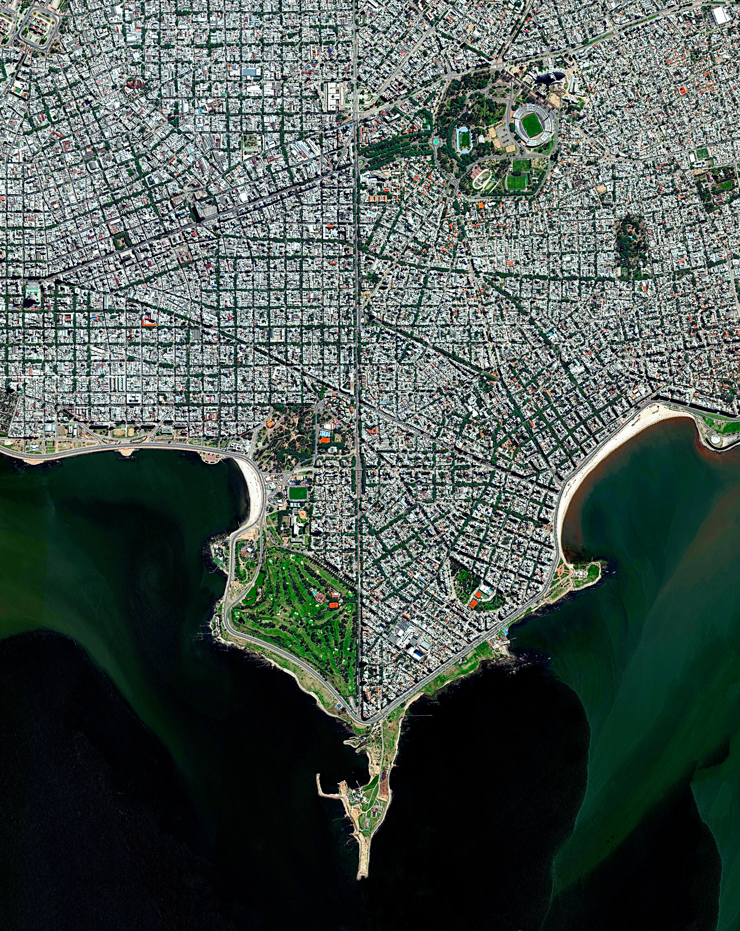 """Montevideo is the capital and most populous city of Uruguay, with about 1.3 million residents — more than one-third of the country's total population. It is also the southernmost capital city in the Americas, located southeast of Buenos Aires, Argentina, across the Río de la Plata. Montevideo is divided into 62 barrios (neighborhoods), each with its own identity, geographic location, and socio-cultural activities.  34°53'01.0""""S, 56°10'55.0""""W  Source imagery: DigitalGlobe"""