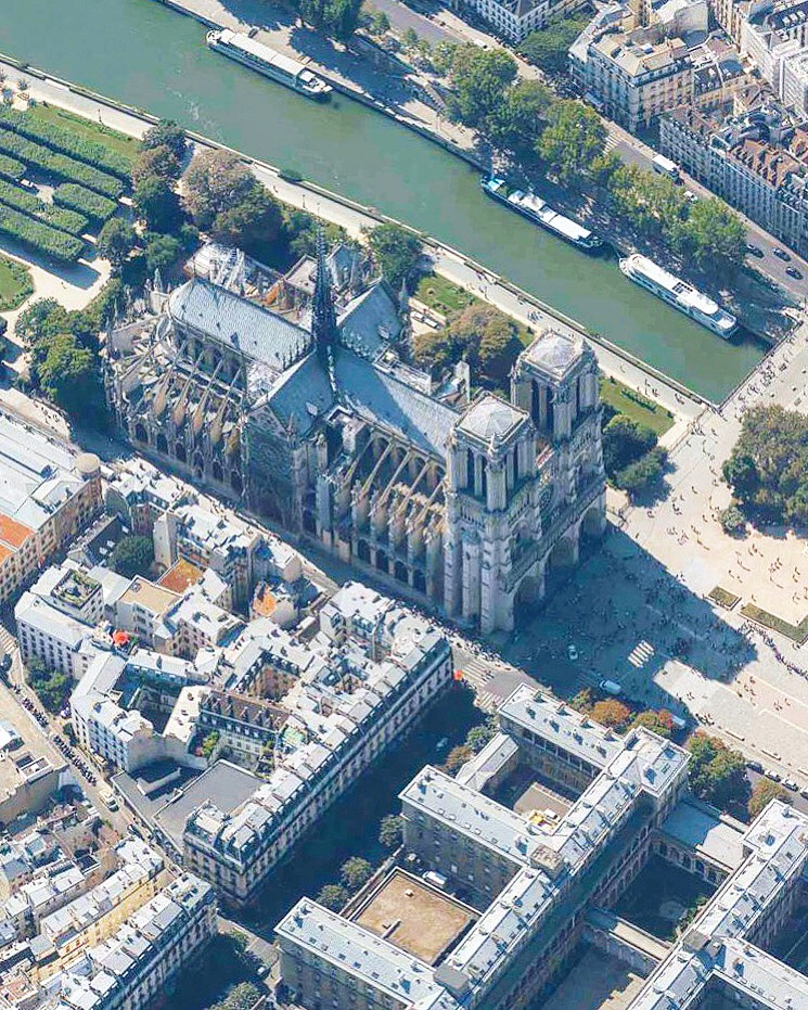 """On Monday, April 15, humanity lost timeless pieces of Gothic architecture when fire nearly destroyed Notre Dame Cathedral in Paris, France. The landmark, which took nearly two centuries to build, lost much of its 800-year-old roof and saw its 19th century spire collapse during the 15-hour blaze. Fortunately, its central structure is still intact, and French President Emmanuel Macron has pledged to restore Notre Dame within five years. This aerial photograph shows Notre Dame before the fire, and we hope to bring you post-fire imagery soon.  48°51'11.3""""N, 2°20'58.4""""E  Source imagery: Geomni Map Pros"""