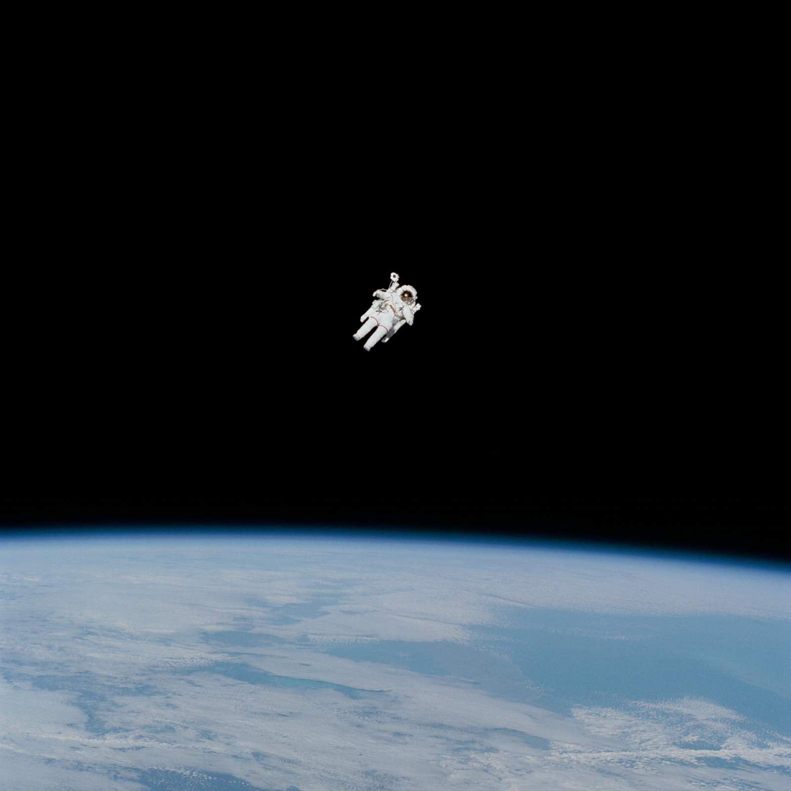 """Today, we're celebrating Earth Day by sharing this incredible photo of the first untethered spacewalk, conducted by NASA astronaut Bruce McCandless on February 7, 1984. Captured by his fellow crew members aboard the Space Shuttle Challenger, this photo shows McCandless approaching his maximum distance from the vehicle. Following the walk, when asked to describe the panorama with the Earth below him, McCandless remarked: """"It really is beautiful.""""  Source imagery: NASA - National Aeronautics and Space Administration"""