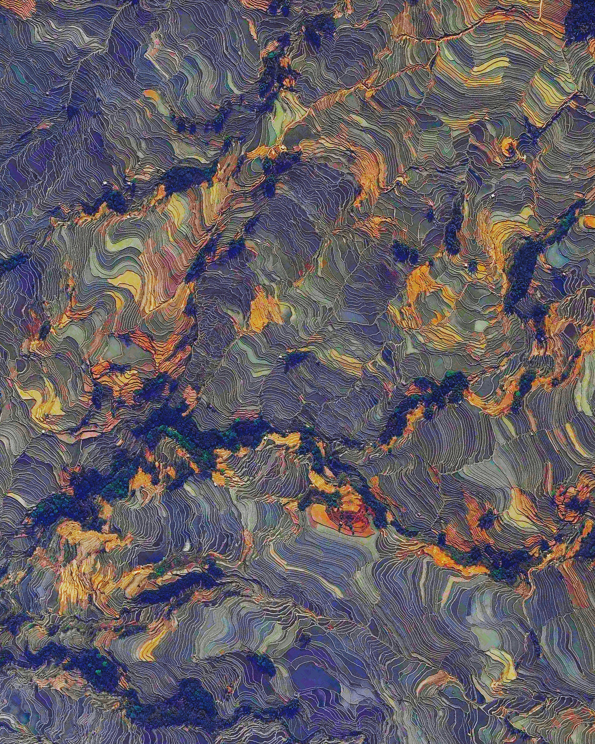 """Rice paddies cover the mountainsides of Yuanyang County, China. Constructed in """"steps"""" by the Hani people for the last 1300 years, the slope of the terraces varies from 15 to 75 degrees with some having as many as 3,000 steps! The stunning colors that you see here are indeed real and result from the presence of water and certain plants within the terraces.  23°09′32″N, 102°44′41″E  Source imagery: DigitalGlobe"""