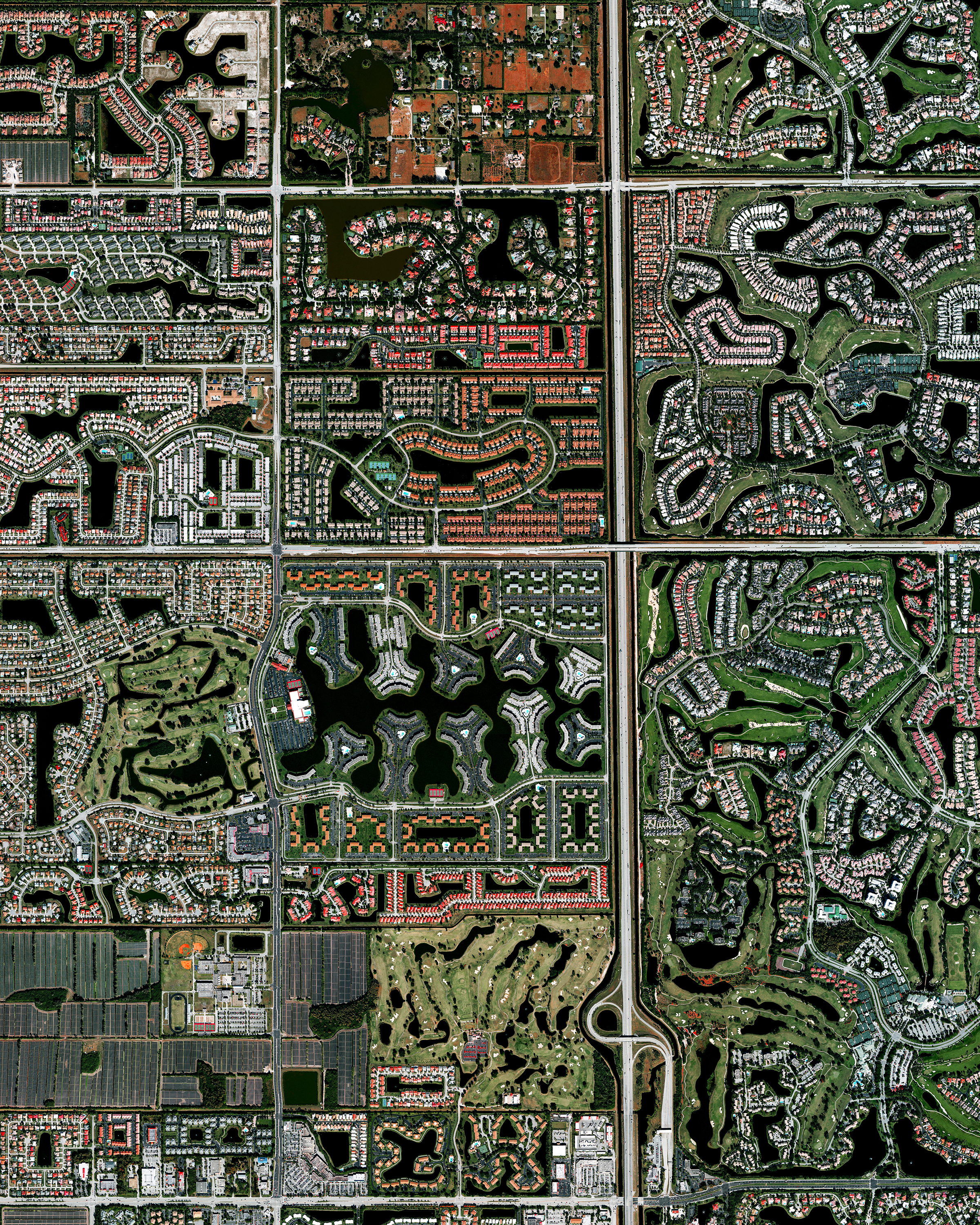 """Residential development is seen in Boca Raton, Florida, USA. Because many cities in the state contain master-planned communities, often built on top of waterways in the latter half of the twentieth century, there are a number of intricate designs that are visible from the Overview perspective. Boca Raton is home to roughly 91,000 residents.  26°23'10.8""""N, 80°10'47.7""""W  Source imagery: DigitalGlobe"""