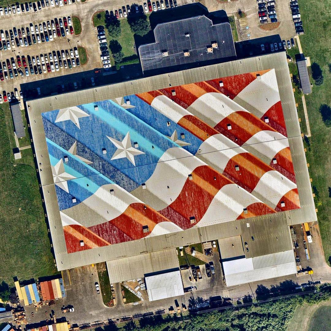"A large mural of the American Flag is seen here on a rooftop near William P. Hobby Airport in Houston, Texas. Painted by artist Scott LoBaido, the piece covers roughly 150,000 square feet (13,935 sq. m) and took nearly three weeks to complete. Today is Memorial Day in the United States, a holiday observed every year on the last Monday of May to remember the men and women who died while serving in the country's armed forces.  29°39'07.4""N 95°17'34.7""W  Source imagery: Nearmap"
