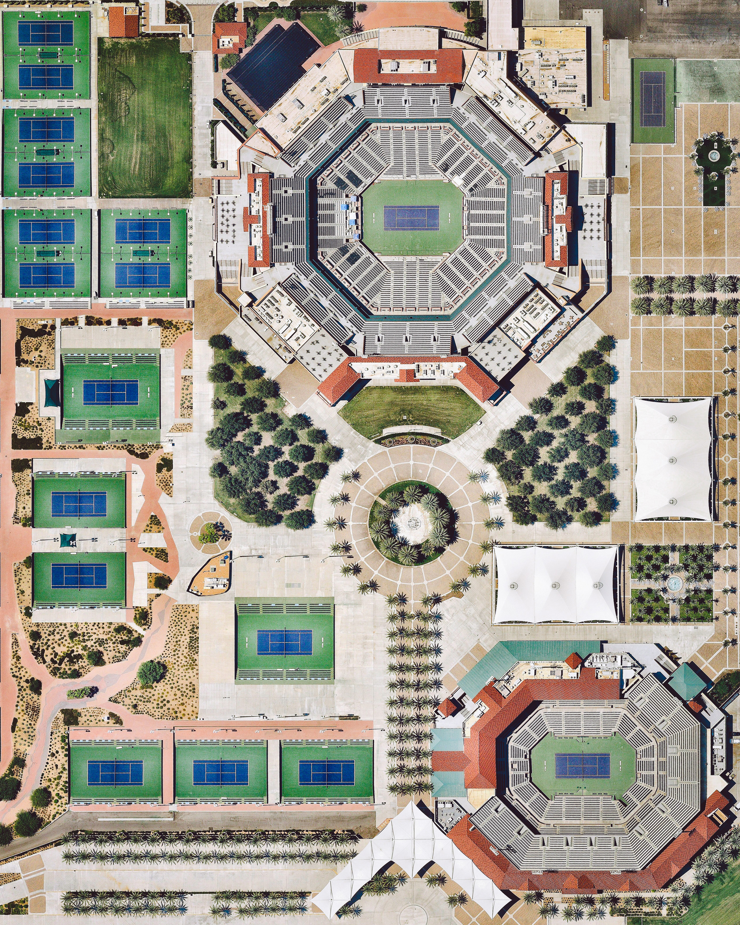 "The Indian Wells Tennis Garden is a 29-court complex located on 88 acres (360,000 sq. m) near Palm Springs, California. Its 16,000-capacity ""Stadium 1"" is the second largest outdoor tennis stadium in the world. Every year, the complex hosts the Indian Wells Masters, also known as the BNP Paribas Open — the best-attended tennis tournament outside of the four Grand Slam tournaments.  33.723541, -116.304663  Source imagery: Nearmap"