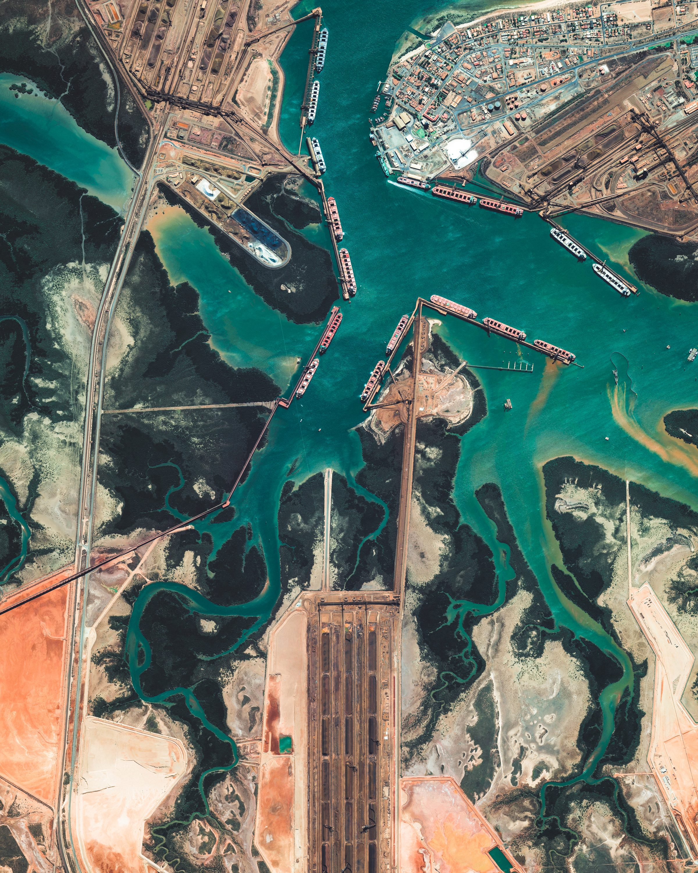 Port Hedland is the largest iron ore loading port in Australia and one of the largest in the world. Located in the Pilbara Region of Western Australia, the port recorded a throughput of more than 519 million tonnes between 2017 and 2018. On December 27, 2017, Port Hedland had its record tonnage on a single tide when eight vessels carried 1,589,061 tonnes through its waters.  -20.342525°, 118.567232°  Source imagery: Maxar Technologies