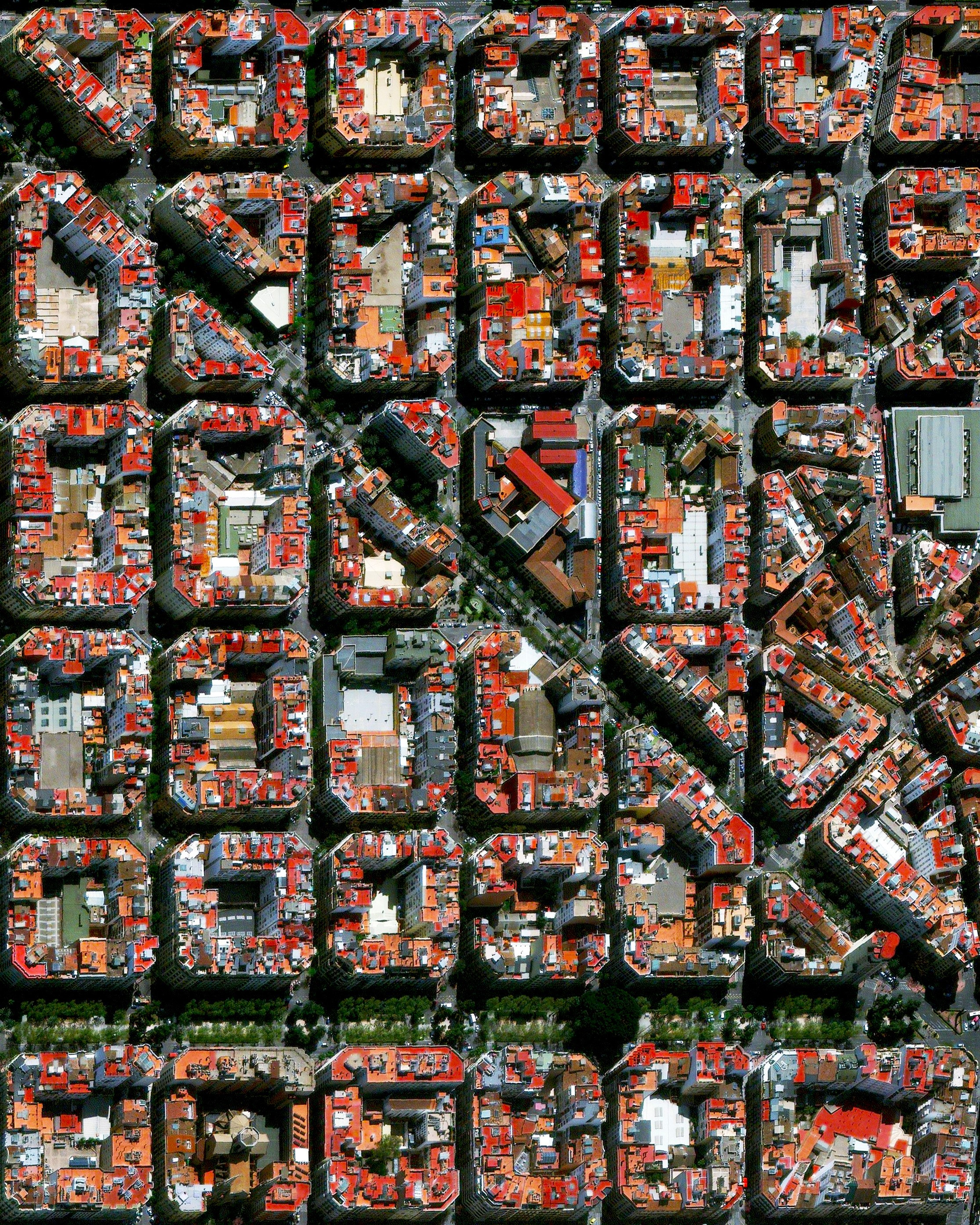 The urban plan of the L'Eixample district in Valencia, Spain, is characterized by long straight streets, a strict grid pattern crossed by wide avenues, and apartments with communal courtyards. A similar layout was used for the district of the same name in Barcelona.  39.464722°, -0.370000°  Source imagery: Maxar Technologies
