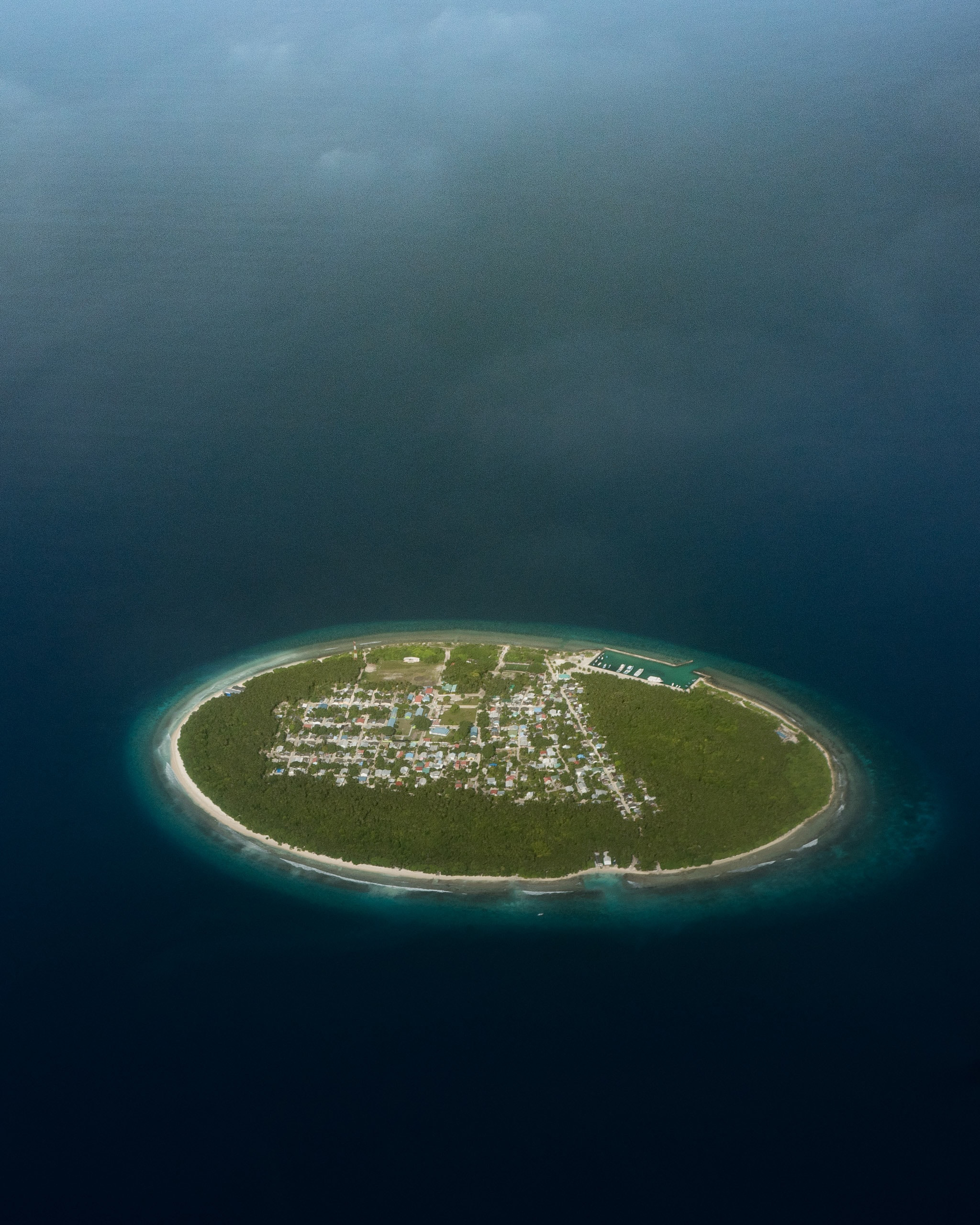 Foakaidhoo is one of 16 inhabited islands in the Shaviyani Atoll of the Maldives. Covering an area of about 0.25 square miles (0.66 square km) in the Arabian Sea, it is home to roughly 1,320 people. The island has several privately-owned shops, a health center, a school for children in preschool through grade 10, and other basic community centers.  6.326389°, 73.149167°  Source imagery: Ahmed Saffu