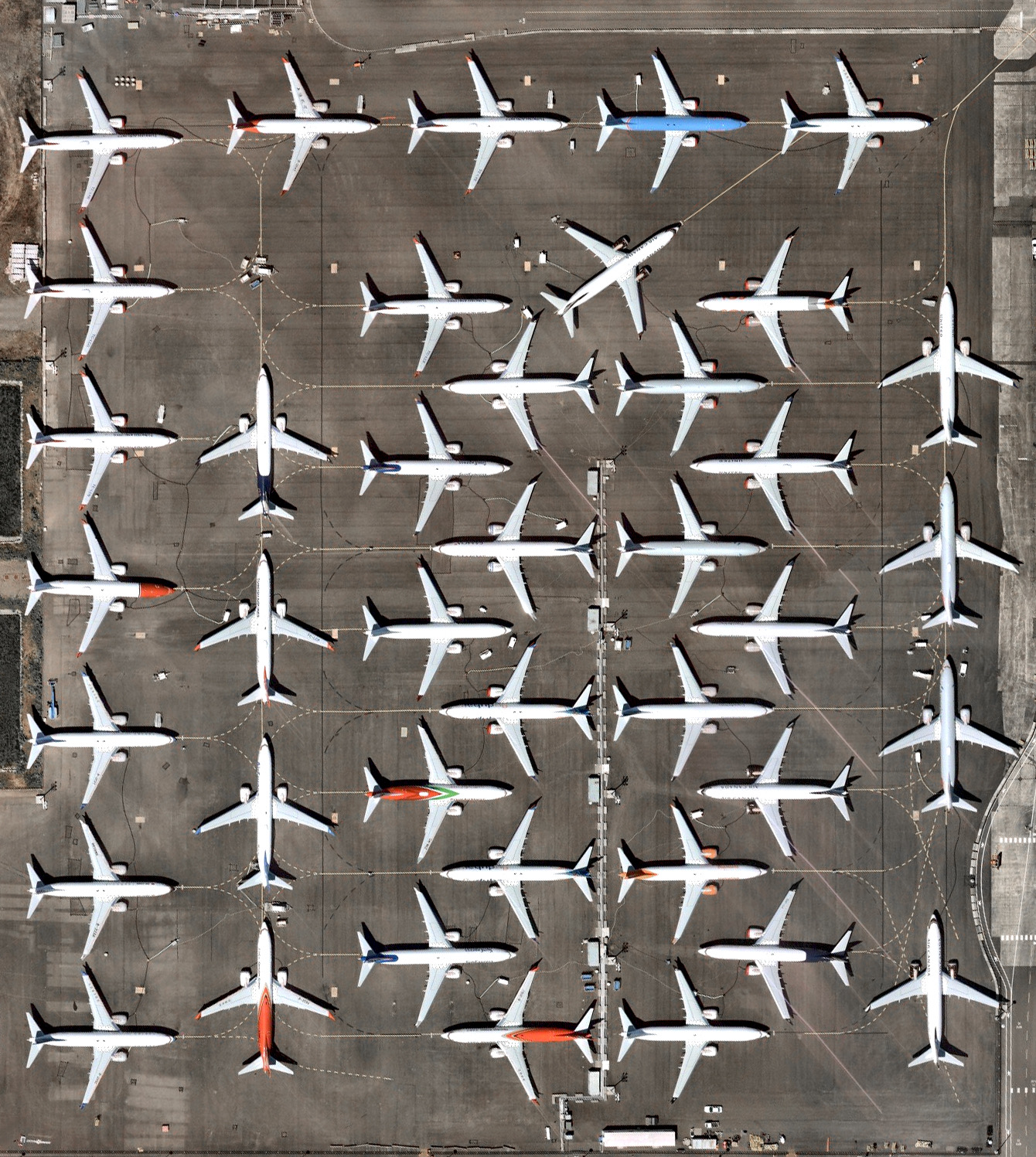 Dozens of 737 MAX jetliners cover a parking lot at Boeing's factory in Seattle, Washington. This model has been grounded since March following two fatal crashes in less than six months. July was Boeing's fifth consecutive month without a new order for the 737 MAX and its least productive month for plane deliveries since November 2008.  47.529245, -122.309162°  Source imagery: Nearmap