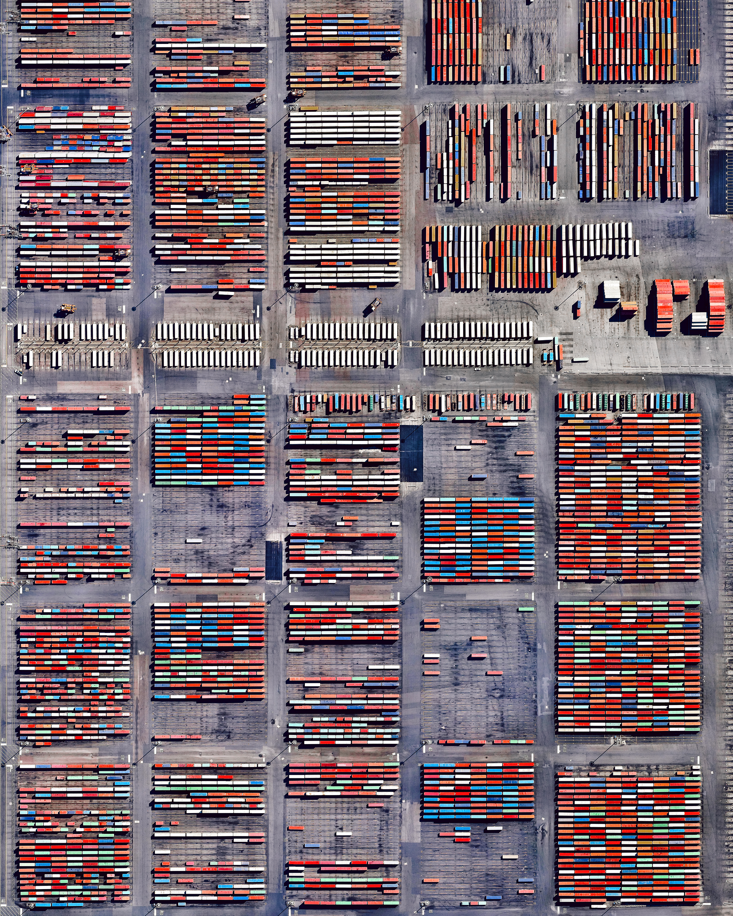 Shipping containers are stacked at the Port Newark Container Terminal in Newark, New Jersey. The massive facility handles more than 1.3 million shipping containers every year and is in the midst of an expansion project that will add capacity for another 1 million containers per year by 2030.  40.681667°, -74.150556°  Source imagery: Maxar Technologies