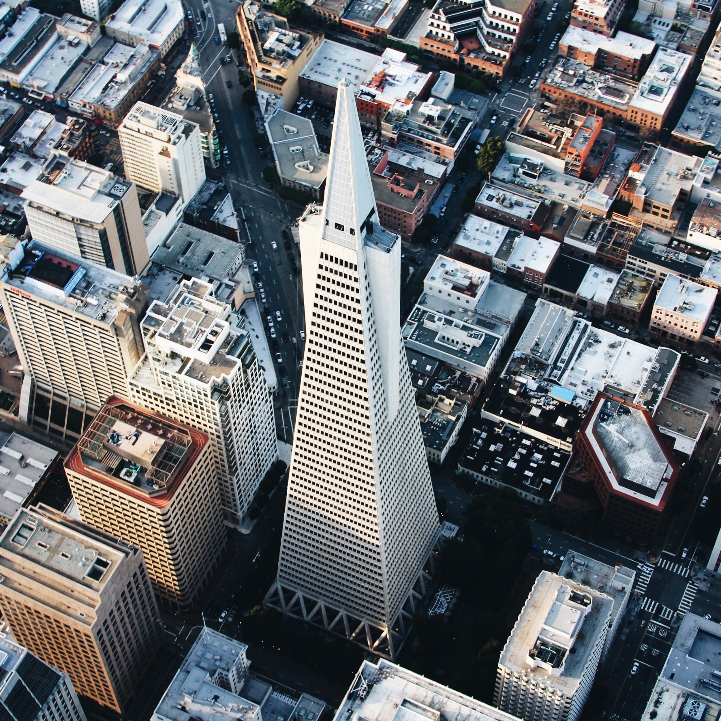"""The Transamerica Pyramid is the second-tallest skyscraper in the skyline of San Francisco, California, at 853 feet (260 m). Its design consists of a tall, four-sided pyramid with two """"wings"""" that accommodate an elevator shaft on the east and a stairwell and smoke tower on the west. Four cameras, pointed in the four cardinal directions, are positioned at the top of the building's spire to form the """"Transamerica Virtual Observation Deck.""""  37.795200°, -122.402800°  Source imagery: Chris Leipelt Photography"""