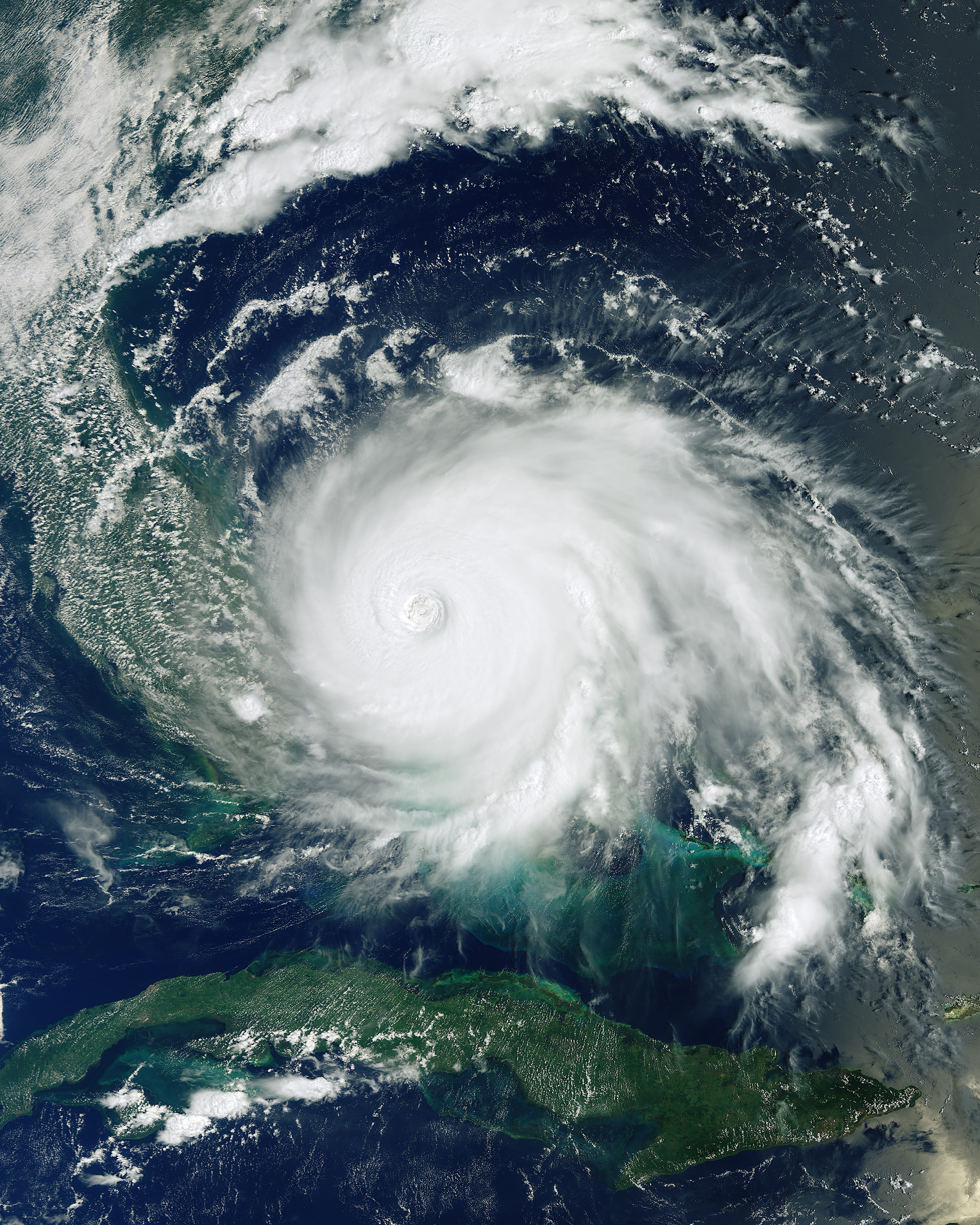 This image, captured by the European Space Agency's Copernicus Sentinel-3 satellite, shows Hurricane Dorian pummeling the Bahamas on Monday, September 2. Having reached Category 5 intensity with sustained winds of 185 mph (295 km/h), the storm is reported to be one of the most powerful Atlantic hurricanes on record. It is currently a Category 2 hurricane and is expected to continue up the southeastern coast of the United States. Several fatalities have been recorded and numerous homes and infrastructure have been destroyed.  24.250000°, -76.000000°  Source imagery: ESA - European Space Agency