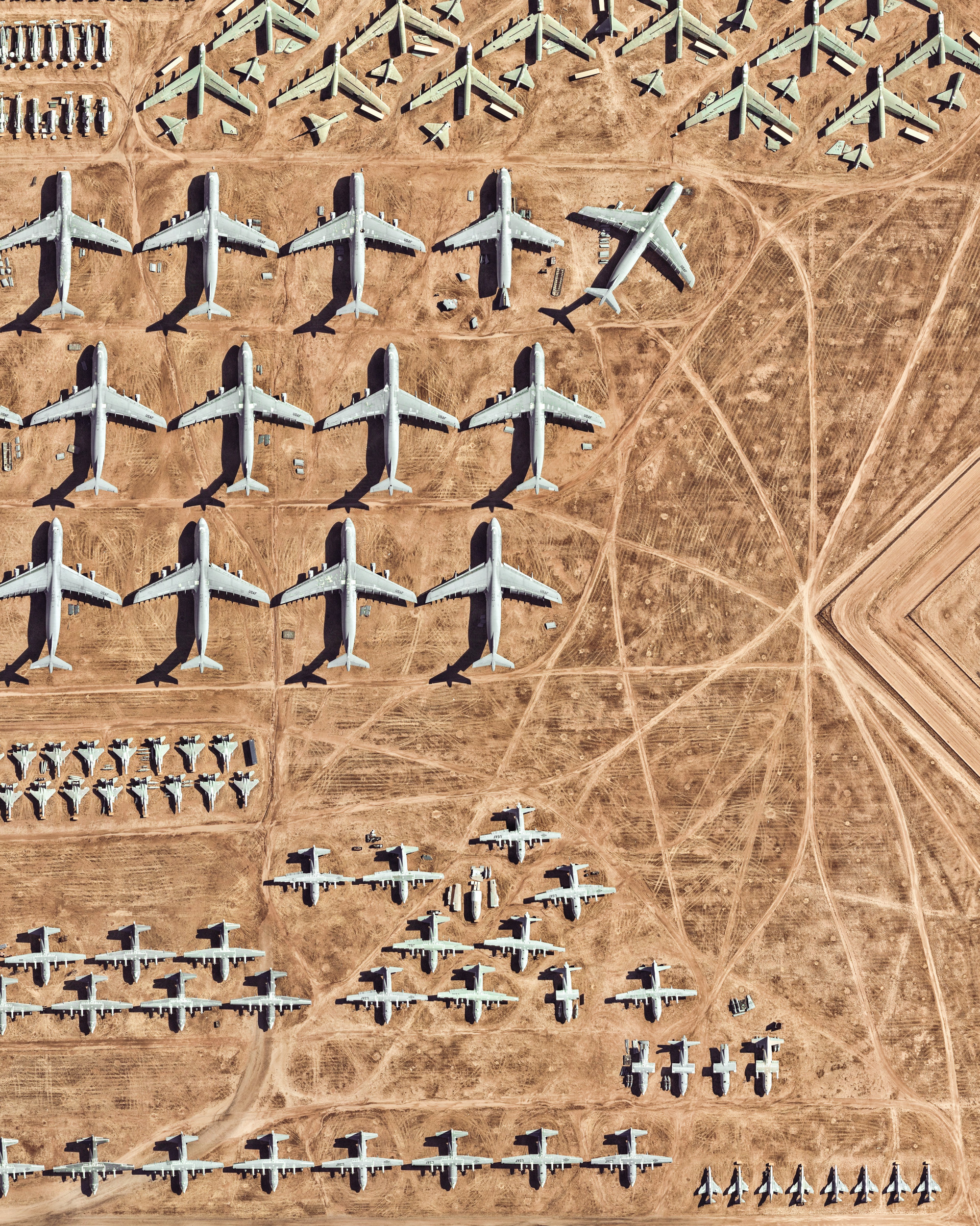 The largest aircraft storage and preservation facility in the world is located at Davis–Monthan Air Force Base in Tucson, Arizona. The facility - run by the 309th Aerospace Maintenance and Regeneration Group - contains more than 4,400 retired American military and government aircraft.  32.150574°, -110.827969°  Source imagery: Nearmap