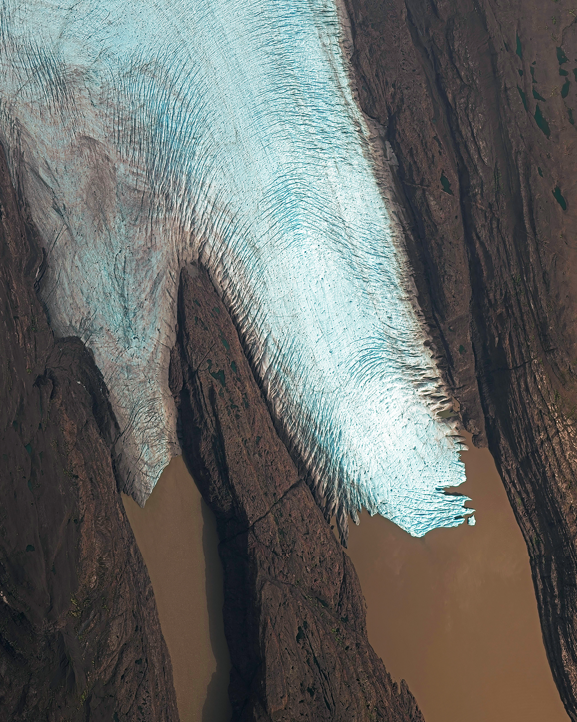 A finger of the Cook Ice Cap meets a fjord on La Grande Terre, the largest of the Kerguelen Islands. Also known as the Desolation Islands, the Kerguelens are located in the Antarctic and are among the most isolated places on Earth — more than 2,100 miles (3,300 km) from Madagascar in the southern Indian Ocean. The islands have no indigenous inhabitants, but since they are part of the French Southern and Antarctic Lands, they host a permanent presence of 45-100 soldiers, scientists, engineers and researchers from France.  -49.258528°, 69.222139°  Source imagery: Maxar Technologies
