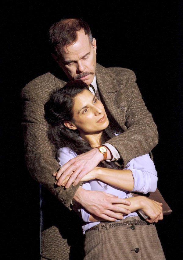 """Photo: David Cooper  """"Laara Sadiq's Ezra is an icon of tightly wound intellect and ambition""""   -The Georgia Straight – Colin Thomas   """"…a provocative play with all 11 roles superbly performed by Murphy, Sadiq, Wheeler and Richards""""   -The Vancouver Courier – Jo Ledingham   """"Touchstone Theatre's West Coast premiere of Anton Piatigorsky's Eternal Hydra is a magnificent dangerous beast""""   -Plank Magazine – Danielle Benzon"""