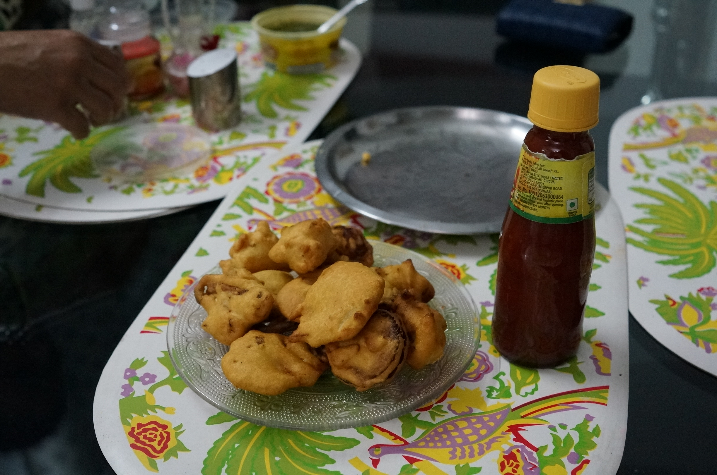 Deep fried veggies(cauliflowers, potatoes, onions). All the veggies are cover with grinder chickpea mix with water.