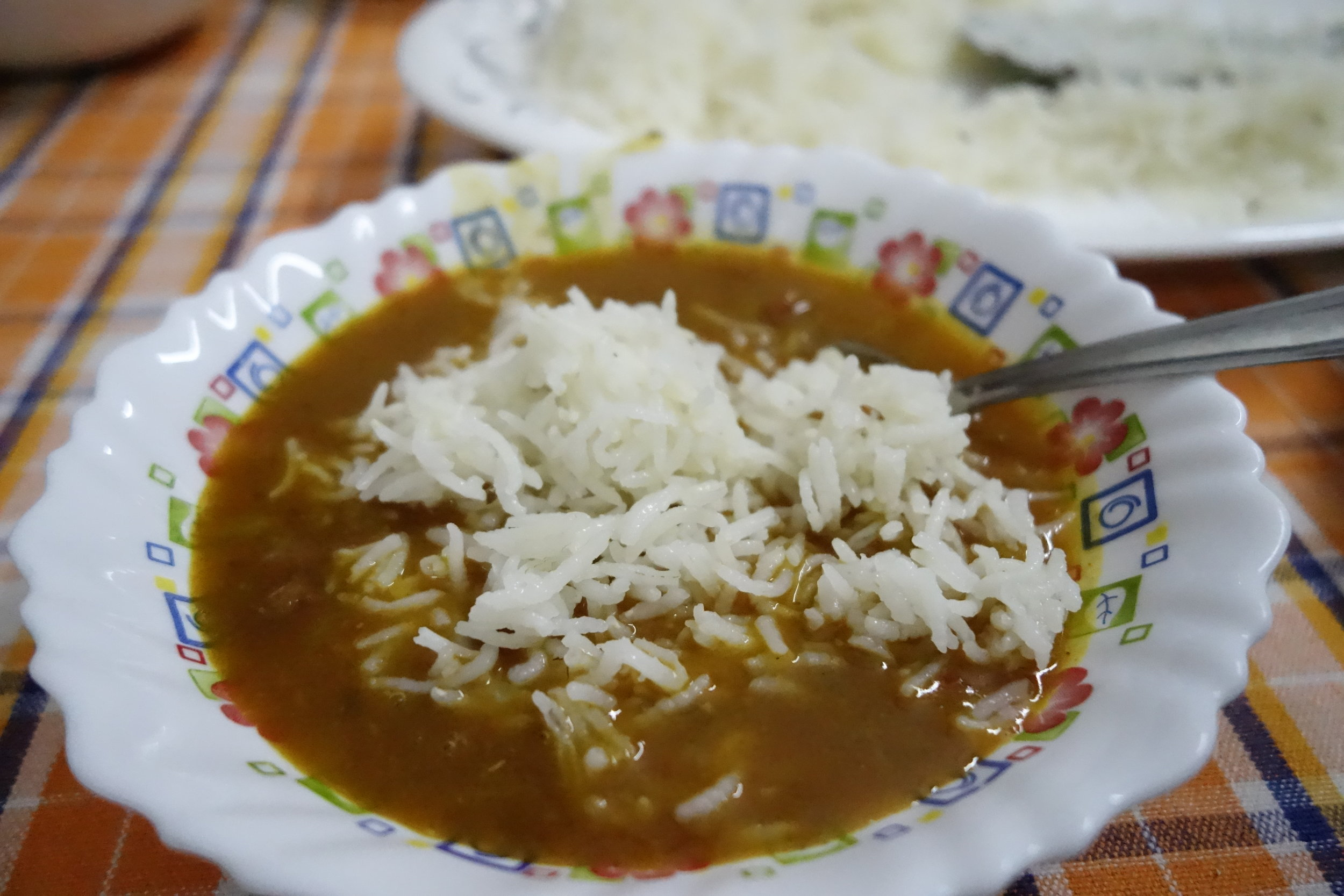 Rajma -popular South Asian vegetarian dish consisting of red kidney beans in a thick gravy with many Indian spices and served with rice.