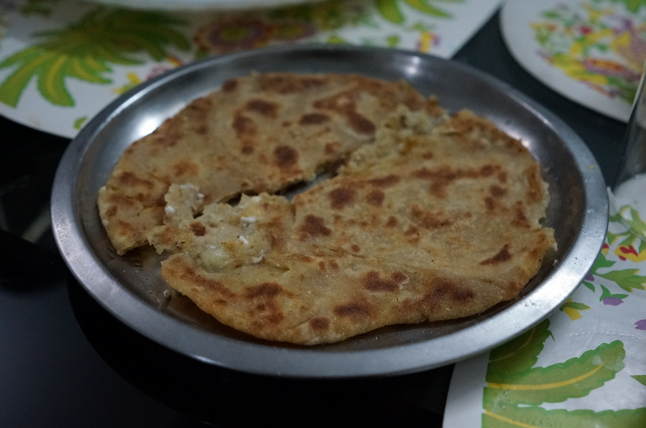 Aloo Paratha - flatbread stuffed with potatoes(stuffed potatoes were made from potatoes, onions, coriander, and spices). The best way to eat this is with ghee!