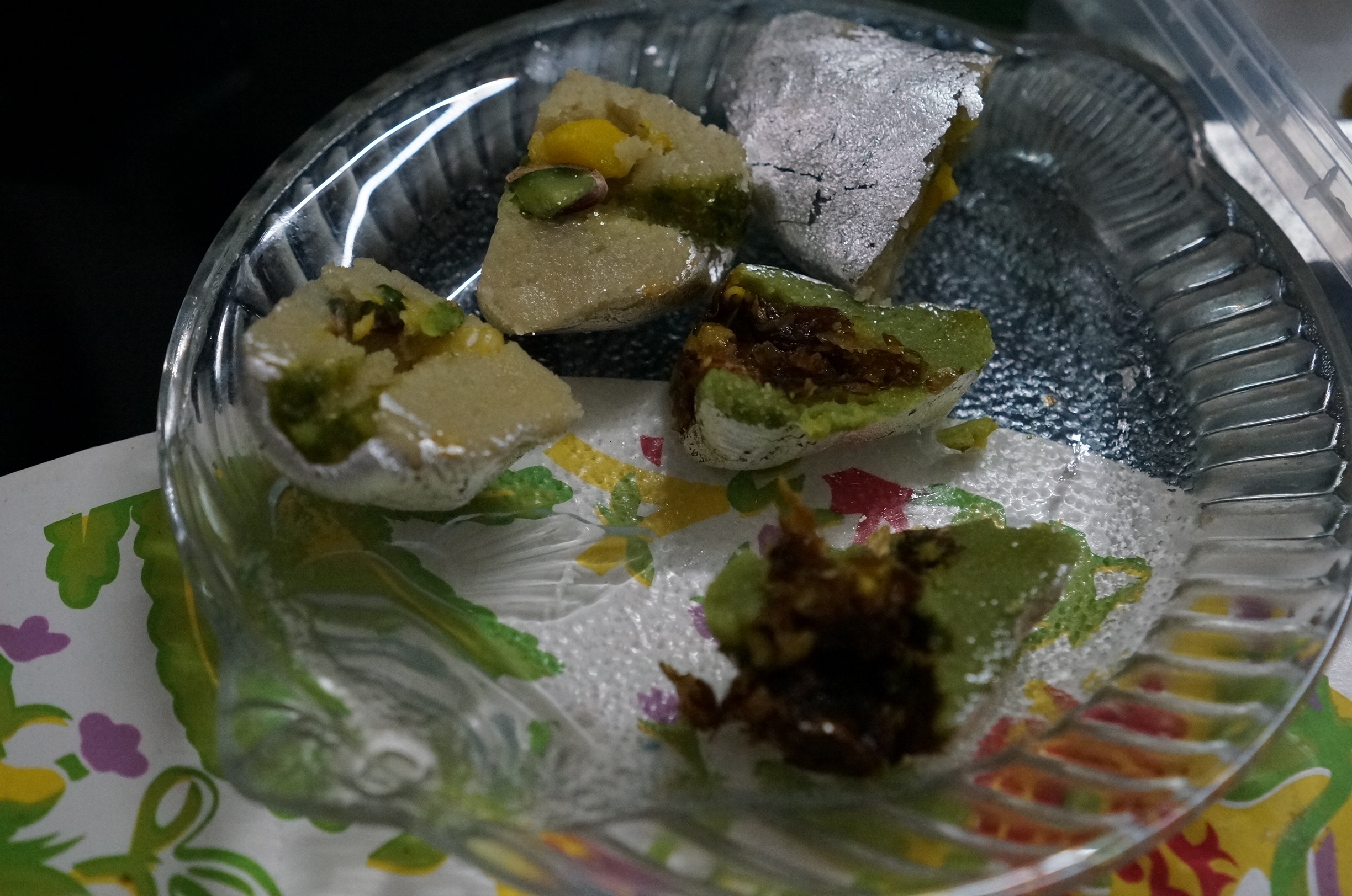 Not sure what is this one call exactly but it's a kind of dessert made from pistachios stuffed with some kind of refreshments and covered with vark which is edible silver.