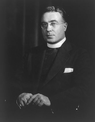 Charles Edward Coughlin, commonly known as Father Coughlin, (1891 – 1979) was a controversial Roman Catholic priest at Royal Oak, Michigan's National Shrine of the Little Flower church. He was one of the first political leaders to use radio to reach a mass audience, as possibly thirty million listeners tuned to his weekly broadcasts during the 1930s.
