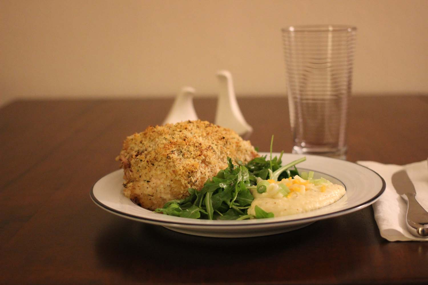 Crispy Mustard Roasted Chicken with Cheddar Grits and Arugula Salad; Image: Laura Messersmith