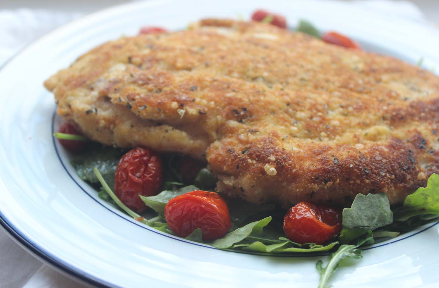 Parmesan Chicken with Arugula and Roasted Tomatoes   Image: Laura Messersmith