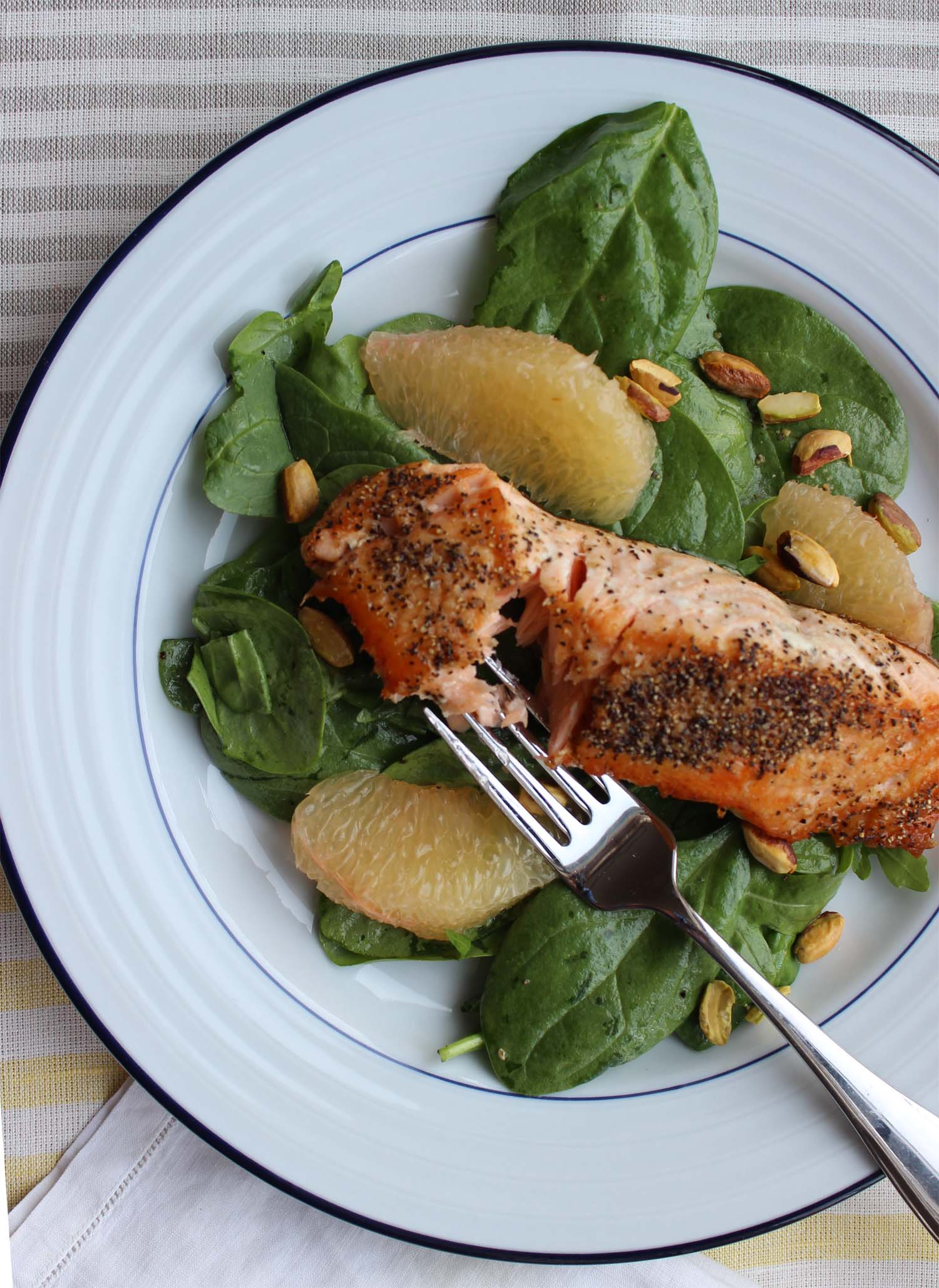 Pan-Fried Salmon with Grapefruit, Pistachio and Spinach Salad   | Image:   Laura Messersmith