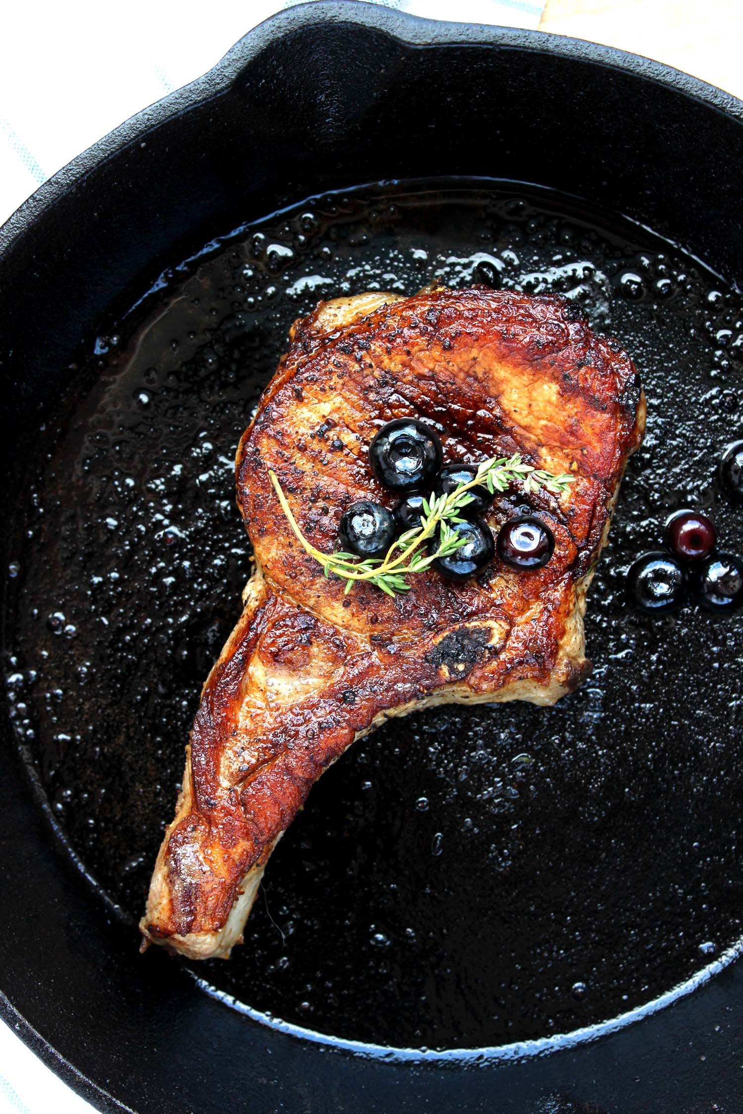 Butter Braised Pork Chops with Blueberry Balsamic Sauce   | Image:   Laura Messersmith