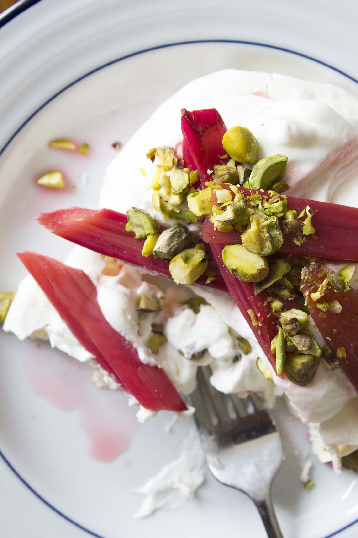 Mini Pavlovas with Roasted Rhubarb and Pistachios  | Image:  Laura Messersmith