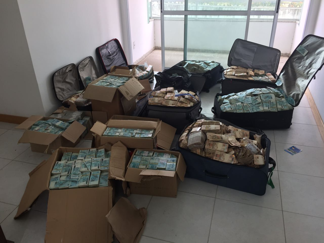 This image of suitcases filled up with money allegedly found stashed in former Finance Minister, Ignatius Chombo's residence are going around social media.