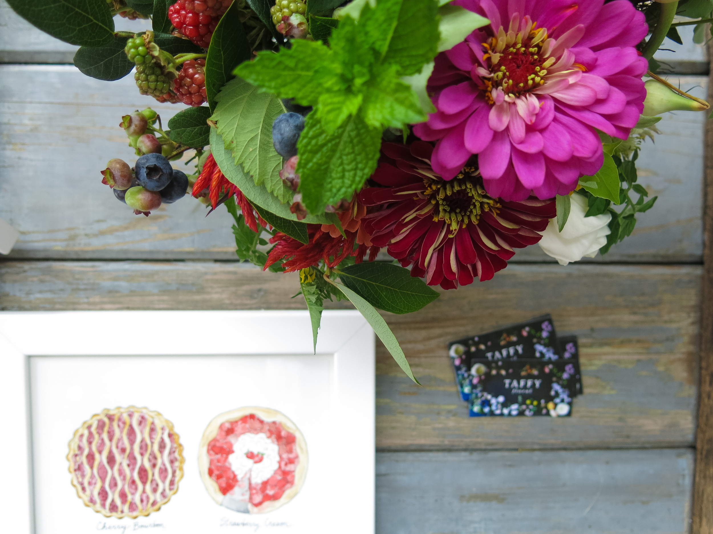 Marcella's work next to an arrangement by Taffy Floral.