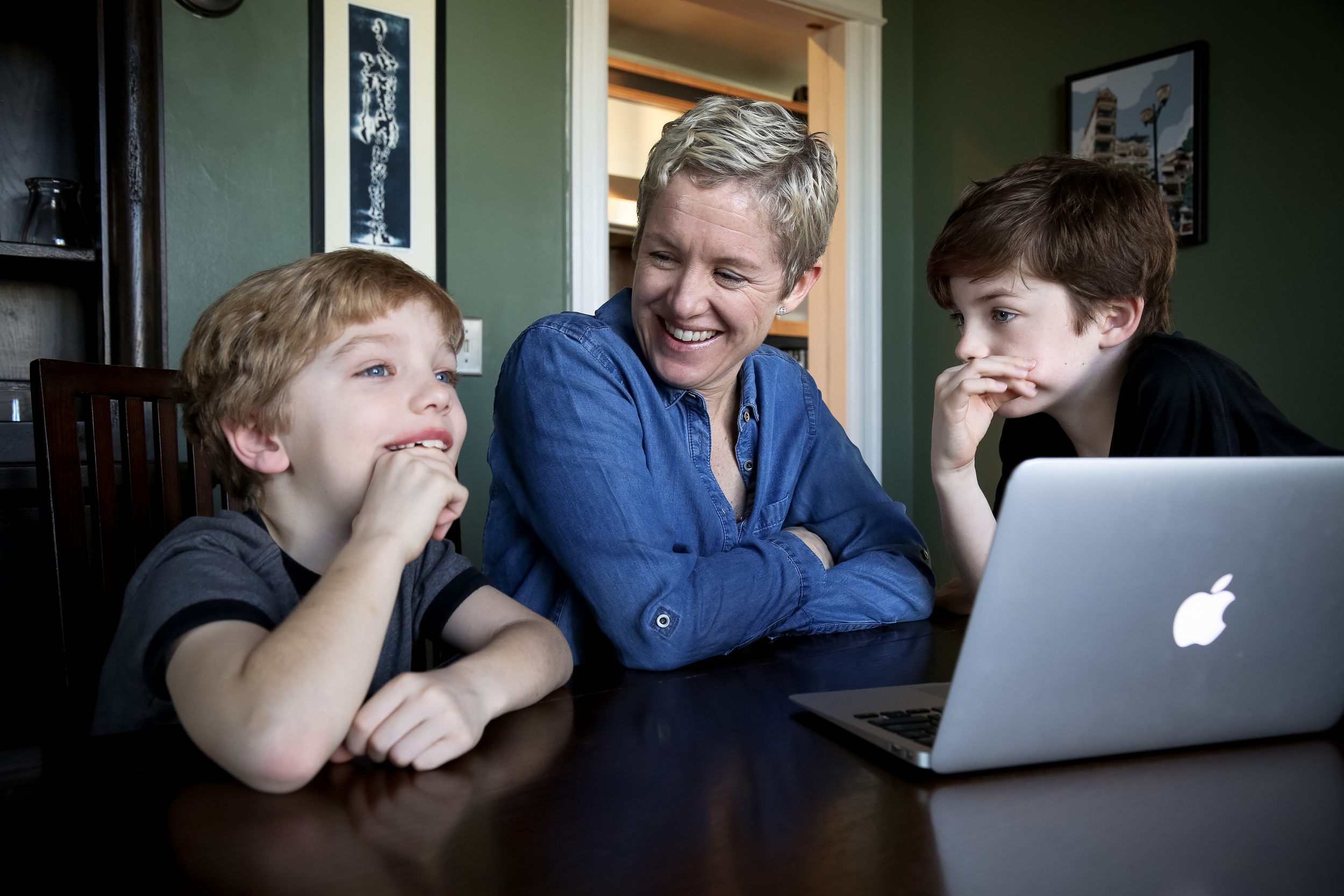 """Lynne McIntyre, Mid-Atlantic regional coordinator for Postpartum Support International, and her two sons, Baird, left, and Calvin, Skype with her husband, Herb Caudill, from their D.C. home."""