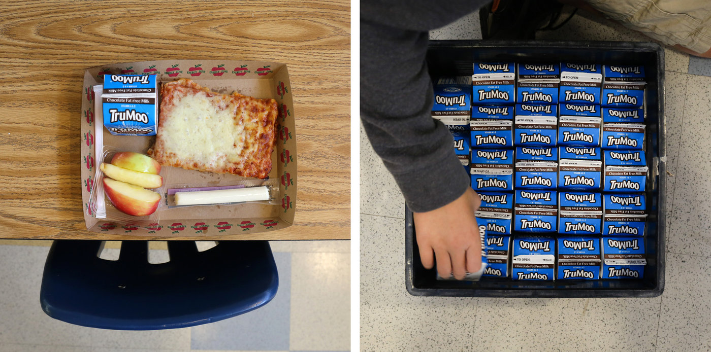 A lunch left behind by a student at Franklin Sherman Elementary School. Unopened milk from lunch is boxed up to be sent to the food bank. Cheese sticks are also donated. Victoria Milko/NPR