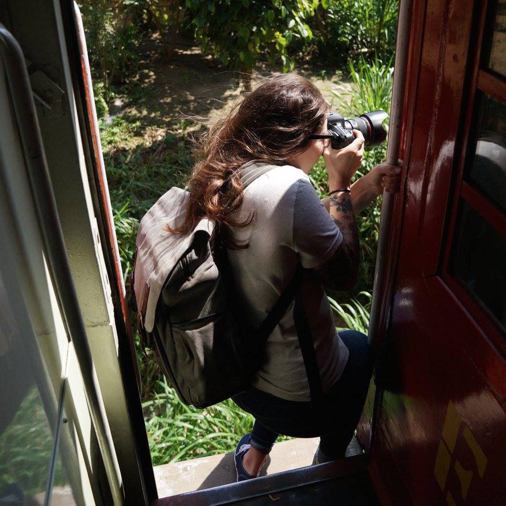 Riding on trains in Sri Lanka. Photo by Laura Bassett